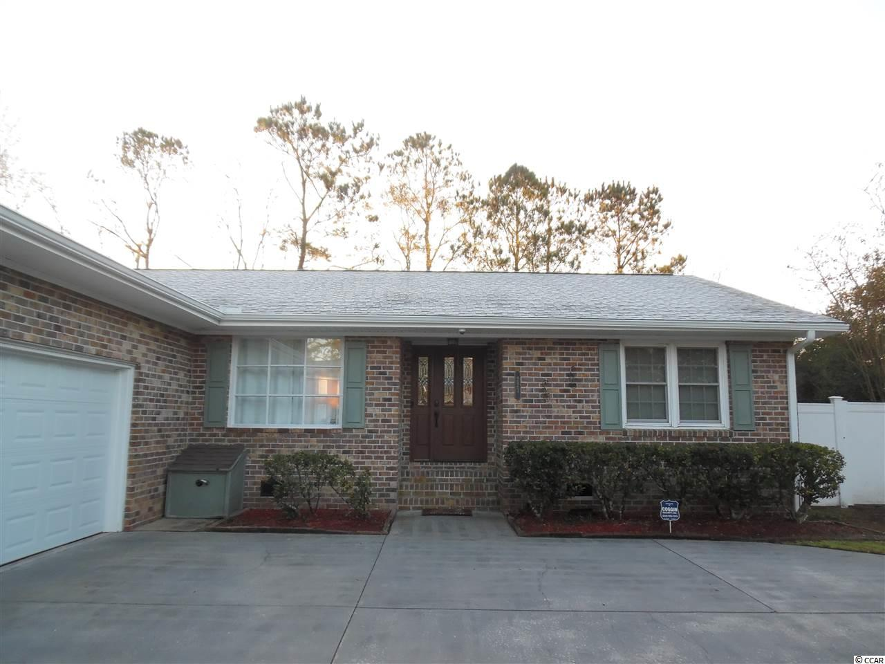 Wanting a cozy home with a fireplace, generous living area, situated on a large lot, fenced in back yard for Fido and close to everything? This 3 bedroom 2 bath home has a double door side load garage, is move in ready and is waiting for you! There is no required HOA or fees. Most of the homes are very well cared for in this community. Singleton Ridge Rd. runs behind this home which is the road that Conway Medical Center is on and all of the other newer medical facilities associated with CMC. Coastal Carolina University, HGTC and Miller-Mott all within a mile. This home is not your run of the mill cookie cutter, built on a generous crawl space and is an all brick home that has granite counter tops, glass and copper backsplash and custom cabinets throughout. There is new laminate wood flooring in a beautiful shade of gray to give it that beach feel. New carpet in all of the bedrooms and closets. All Whirlpool Stainless Steel appliances. Huge entertainment deck on the rear and plenty of parking in the extended driveway. Plenty of exterior storage and a new concrete slab for another hobby house. Close to shopping, fire stations and less than 15 miles to the beautiful Atlantic Ocean! Call for a showing soon. Seller willing to contribute toward buyer's closing costs and is offering a Buyer's Agent  Bonus with acceptable offer.