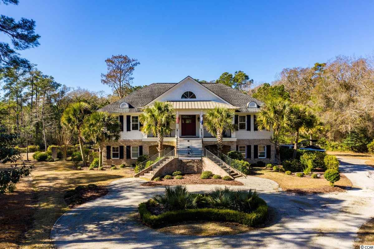 From the River to the Ocean.....The Prince George Community is a coastal sanctuary for residents that truly is one of the most unique neighborhoods on the East Coast.   This custom home is perfectly designed for indoor and outdoor living. Entering the guest level you will find two bedrooms, two baths, laundry room, and den with kitchenette. A large four seasons room overlooking the pond and private yard brings the outdoors in. The main floor with beautiful foyer, den, formal dining room, wet bar, and well appointed kitchen overlooking the serene pond will give you the sense of welcome in every way.  The prominent master bedroom with sitting/office space, ample closet space, en-suite bath will make any owner happy.   A screened porch provides outdoor entertaining spaces as well.  Prince George is located between Pawleys Island and historic Georgetown, SC.  The residents of Prince George enjoy private ocean access, a garden like recreational area that includes a spa and crystal blue swimming pool, clubhouse, tennis, basketball, bocce, volleyball and more.