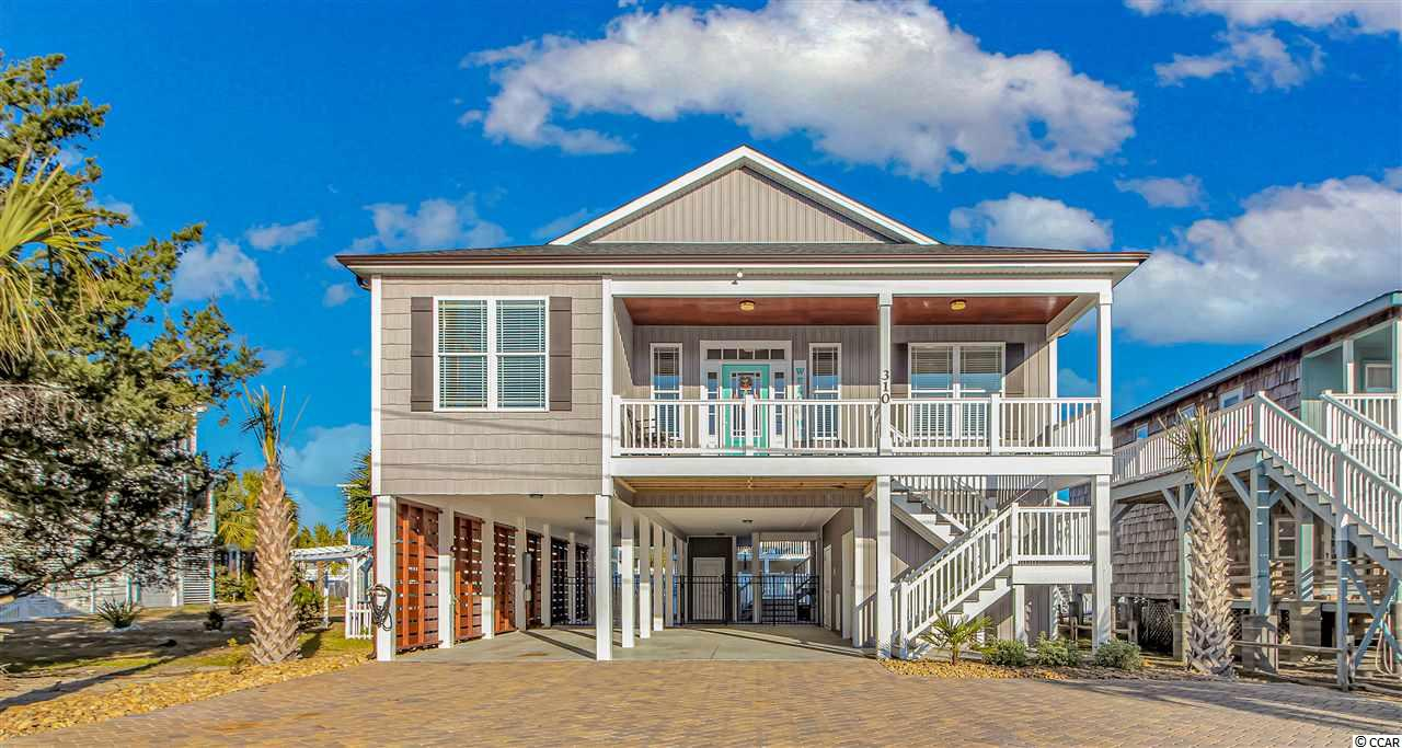 Professional photos being edited and added asap. This well appointed Raised Beach Home in the heart of Cherry Grove has it all....inside and out and is just a YEAR OLD! Tasteful UPGRADES and selections will not disappoint even the most selective buyer. Beautiful luxury vinyl plank floors thruout entire home...granite countertops in kitchen w subway tile backsplash-granite ctrtops with soft close cabs in all baths! Upgraded light fixtures thruout-Kitchen boasts GE SS appliances, white shaker soft close cabinets w custom pull out drawers for maximal storage.Under cab lighting,farmhouse size sink, raised bar area for entertaining. Owner's suite bath has oversize tiled shower w rainhead and handheld sprayer.Large bedrooms, custom queen bunk beds in back BR--all other beds are King-home sleeps 10 privately and has additional 2 sleeper sofas. All furniture bought new when home was built. TV's in all BR's.Ceiling fans thruout. W/D with blt in cabs for plenty of storage.ELEVATOR!!!  Outdoor entertaining at it's finest! Screen porch w storage closet overlooks custom pool w travertine surround and high end furnishings.  Fenced entertaining area pulls all the stops-owner's added an additional bathroom in the large storage area for easy access from the pool- do not have to go into the home-separate private outside shower, golf cart garage. Paver driveway.Upgraded privacy slats add to the charm of the outdoor living area. LOCATION-yes you get that too! GRAB YOUR CHAIR AND WALK TO THE BEACH/GOLF CART/RIDE YOUR BIKE-YOU HAVE IT ALL AND CAN DO IT ALL HERE! JUST SHOW UP WITH YOUR BATHING SUIT AND FLIP FLOPS!  Convenient CG location to restaurants,shops and CG attractions.  In April, 2019, Cherry Grove Beach was in TripAdvisor's. top 25 US Beaches coming in at #11.  Safest city #7 ranked by Alarms.com. Family oriented beach with activities/sites for everyone!   GOLF CART AND A FEW OTHER PERSONAL ITEMS DO NOT CONVEY.
