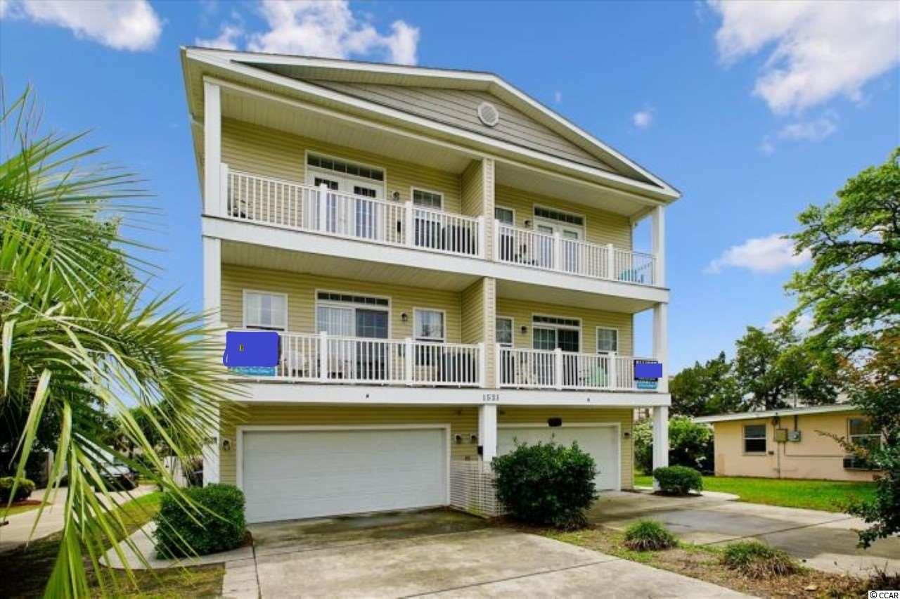 Great opportunity to own a rental property approximately 3 blocks to the beach and has a glimpse of the ocean from the top floor balconies.  This huge duplex features a total of 9 bedrooms and 10 full baths with 2 half baths.  Some features of each side are a game room with pool table, private pool, garage, granite counters, stainless type appliances, jacuzzi tubs, laundry room with washer dryer, 3 large balconies, patio by the pool, and much more.  It is conveniently located close to dining, shopping, golf, entertainment, and all the Myrtle Beach area has to offer.  Don't miss this opportunity.