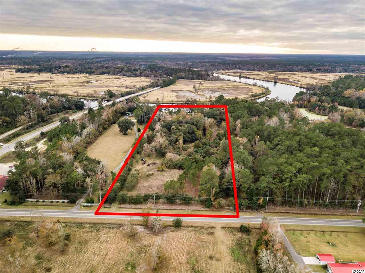 Beautiful 10 acre mini-estate lot fronting on the Black River w/private boat ramp, boat dock & pond.  Landscaped entrance on Choppee Road w/Majestic oaks, magnolias and wildlife.