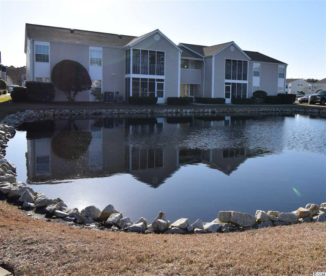 Beautifully furnished condo just 2.6 miles to beach can be YOUR oasis in the South Bay Lakes paradise!  Used only as second home and no more than 3 mo. out of the year this home is like NEW NEW NEW!  Enjoy the screened porch with easy-care indoor/outdoor carpeting and large storage closet overlooking peaceful pond! Well-maintained home with NEW HVAC in 2012 serviced twice a year, NEW windows in 2016, NEW glass in sliding  door and bathroom.  NEW kitchen cabinets and all appliances in 2014.  Gorgeous updated bathrooms with NEW toilets, vanities, paint, mirrors, light fixtures, toiletry holders and even switch plates!  NEW queen mattresses in 2016 to include NEW comforters.  NEW flooring (Cali Bamboo in baths - waterproof, and Oak in rest of home), NEW paint in unit and elegant dining table, high-end leather sofa, top-of-the-line recliners, NEW water heater 2018, NEW disposal 2019 (never used!), NEW light fixtures in living and dining areas!  This home is move-in ready and close to shopping/entertainment with easy access to Bypass 17.  Call for your personal tour and make this your DREAM HOME today!