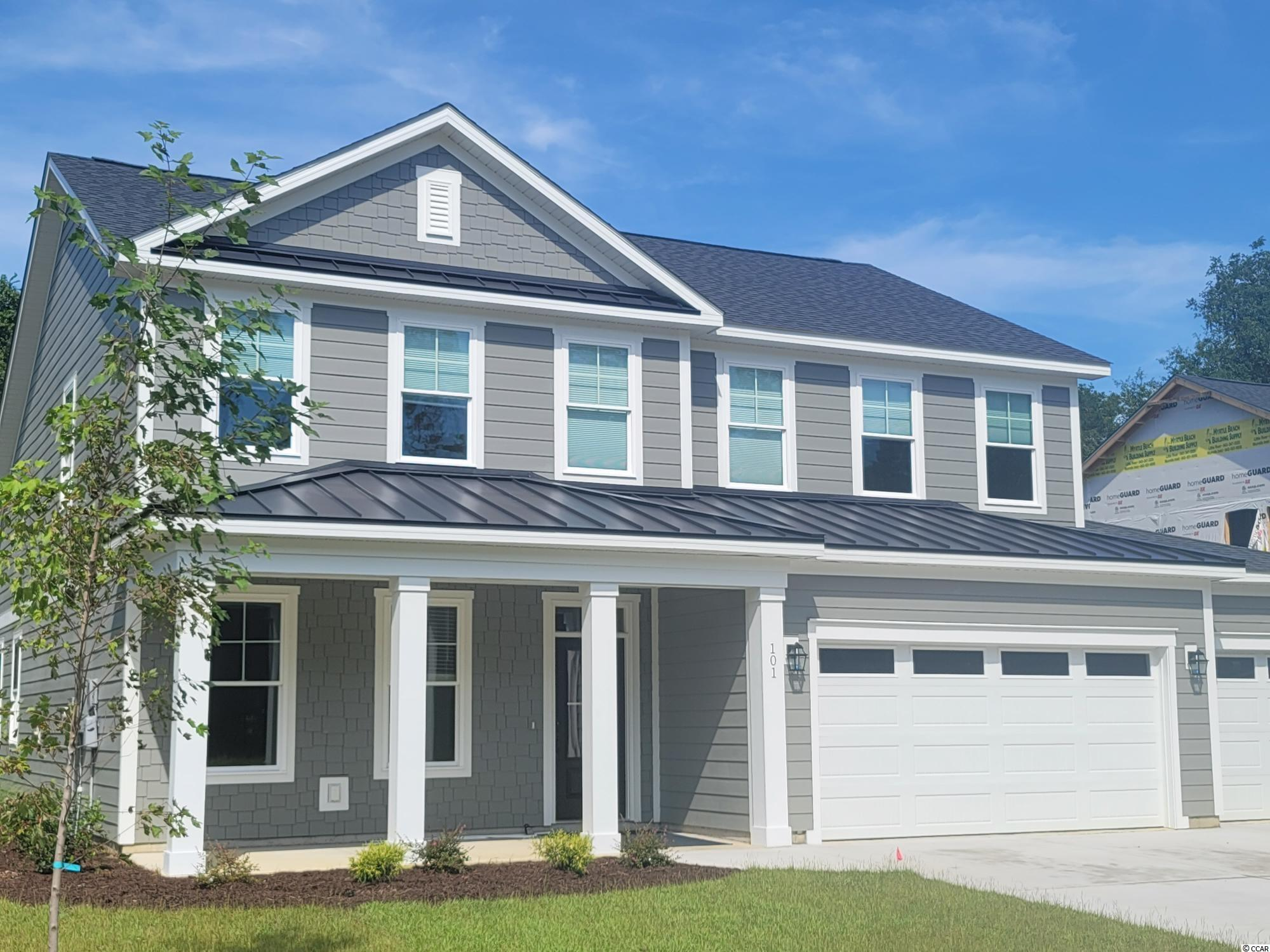 Summer move in!  Caroline Court is Murrells Inlets newest boutique community.  20 homesites and 6 plans to chose from.  This classic home will feature 4 bedroom, 2.5 baths and a 3 CAR GARAGE!  The first floor owners retreat has plenty of storage with 2 walk in closets.  The owner's bath features a huge walk in shower, double sinks, and a separate water closet. Caroline Court offers easy access to the Waccamaw River and public boat launch, Marshwalk, and area beaches.