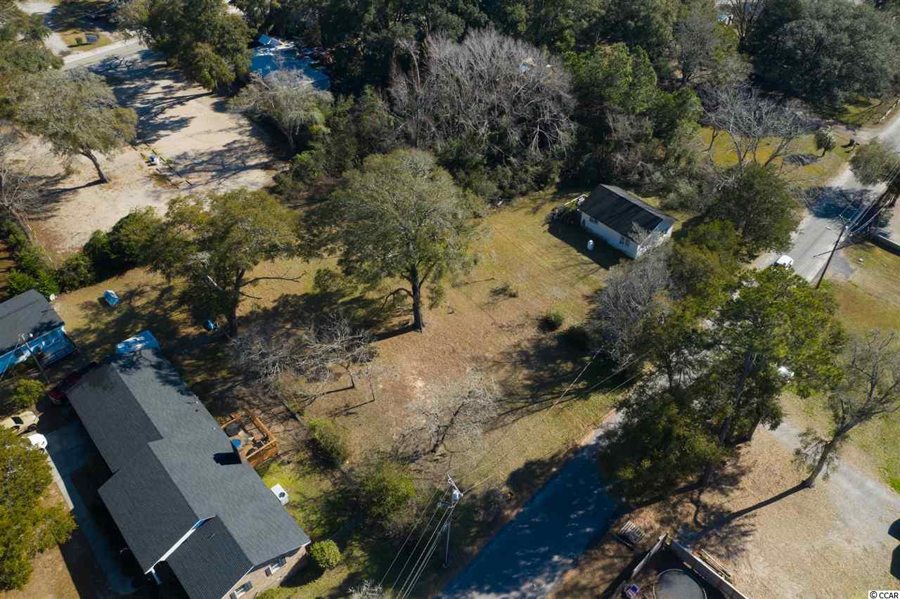 What an incredible opportunity to own not one but 2 cleared lots on the horseshoe in Little River where the Casino Boat is located. This spacious lot offers so much adventure with Intercostal Waterway views, walking distance from local restaurants and lounges, and host the Worlds Famous Blue Crab Festival every May. Live oaks on this just shy of a half acre will sure make a fantastic spot for your new home!
