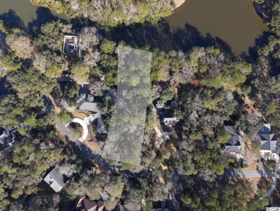 Dotted with live oaks, this deep lakefront homesite is larger than many lots in DeBordieu. Calais Avenue is centrally located to all DeBordieu has to offer - just a short golf cart ride from the Golf Clubhouse and Pete Dye golf course. DeBordieu's oceanfront Beach Club, private beach, boat ramp to North Inlet, and tennis & fitness centers are also just minutes away.