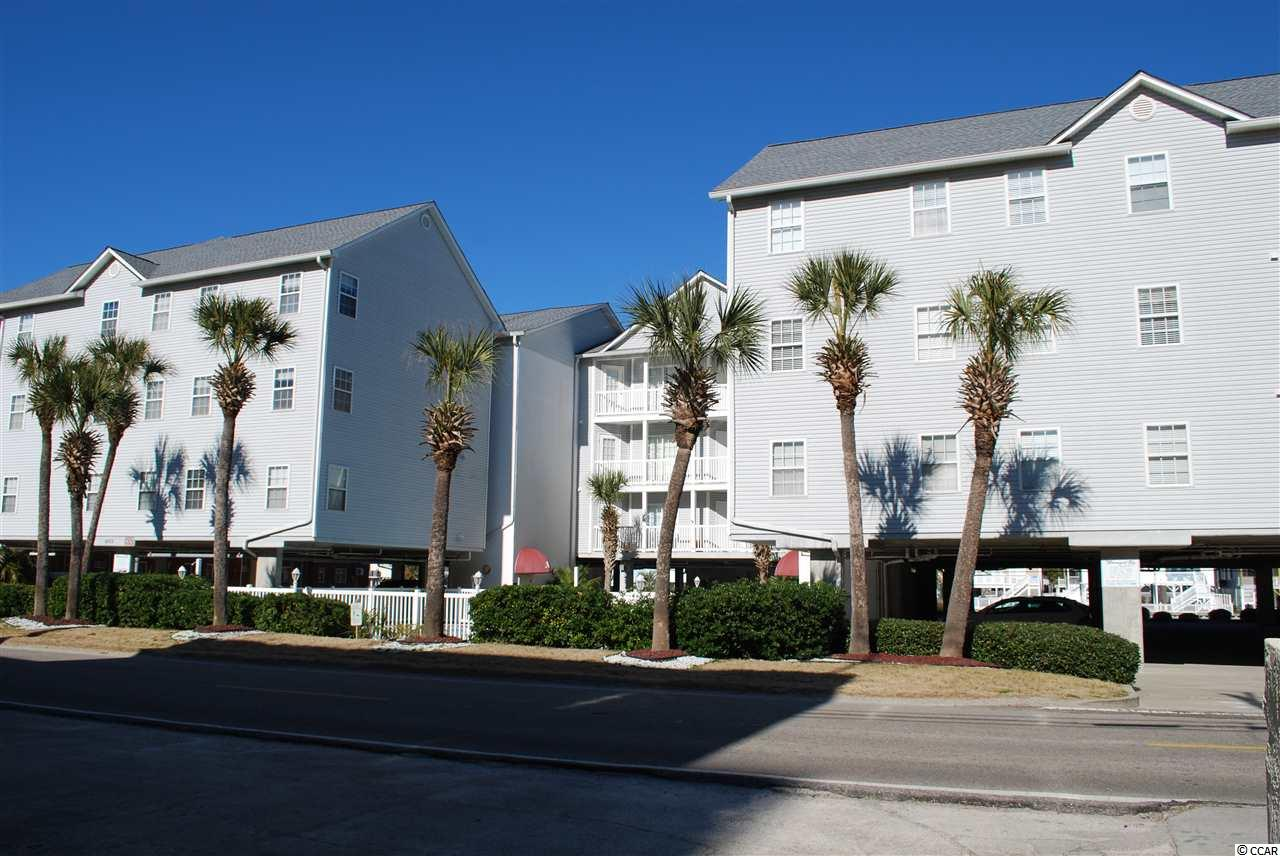 Cherry Grove area. Fully furnished, 2 bedroom, 2 bath condo in a well maintained elevator building in the desired section of Cherry Grove. Tiled hallways throughout the building. condo has an open design with sliding doors to balcony from living room and master bedroom. Master bath has extra sink outside of bathroom for convenience. Second bedroom has 2 beds and also has a separate entrance from outside, so it could be used as a lockout room if necessary. There is tile on the counters in the kitchen that make cleanup easy. Washer and dryer are new as of 2019 and laundry room has some room to have pantry items. There is a slight view of the ocean and the marsh from the balcony. There is a owner's storage closet on the balcony and a designated storage locker in the parking area for your beach gear. This complex is located on a channel with a pier for sitting and enjoying nature. There are grills and a picnic area for owners use. The roof on the building was just replaced and the HVAC in the unit was replaced in 2016. Sit by the pool or step across the street to enjoy the beach. This is a great location and a short drive to enjoy all that North Myrtle Beach has to offer.