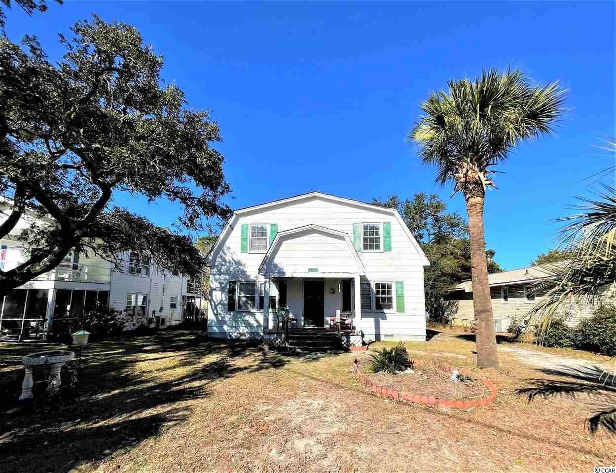 1802 Havens Dr. in North Myrtle Beach presents a unique, fixer-upper opportunity for the right homeowner or real estate investor! This 4 bedroom, 2 bathroom, Dutch Colonial style home isn't something you see at the beach everyday! Loaded with quaint features, exposed 20' ceilings, and stately views from the catwalk, this property is sure to dazzle. Some of these features include the original hardwood floors, grand staircase, built in bookshelves, first and second floor bedrooms, and the abundance of natural South Carolina sunshine beaming through the windows. This home sits on a large lot that is just under a quarter acre and is nestled approximately 2 blocks from the beach and the beautiful Atlantic Ocean. If you are looking for a vacation home, a full-time residence, or an investment opportunity this home has remarkable potential when paired with the right person's drive and vision. Property will be sold as-is. Information and measurements are estimated and should be verified by the buyer and/or the buyer's agent