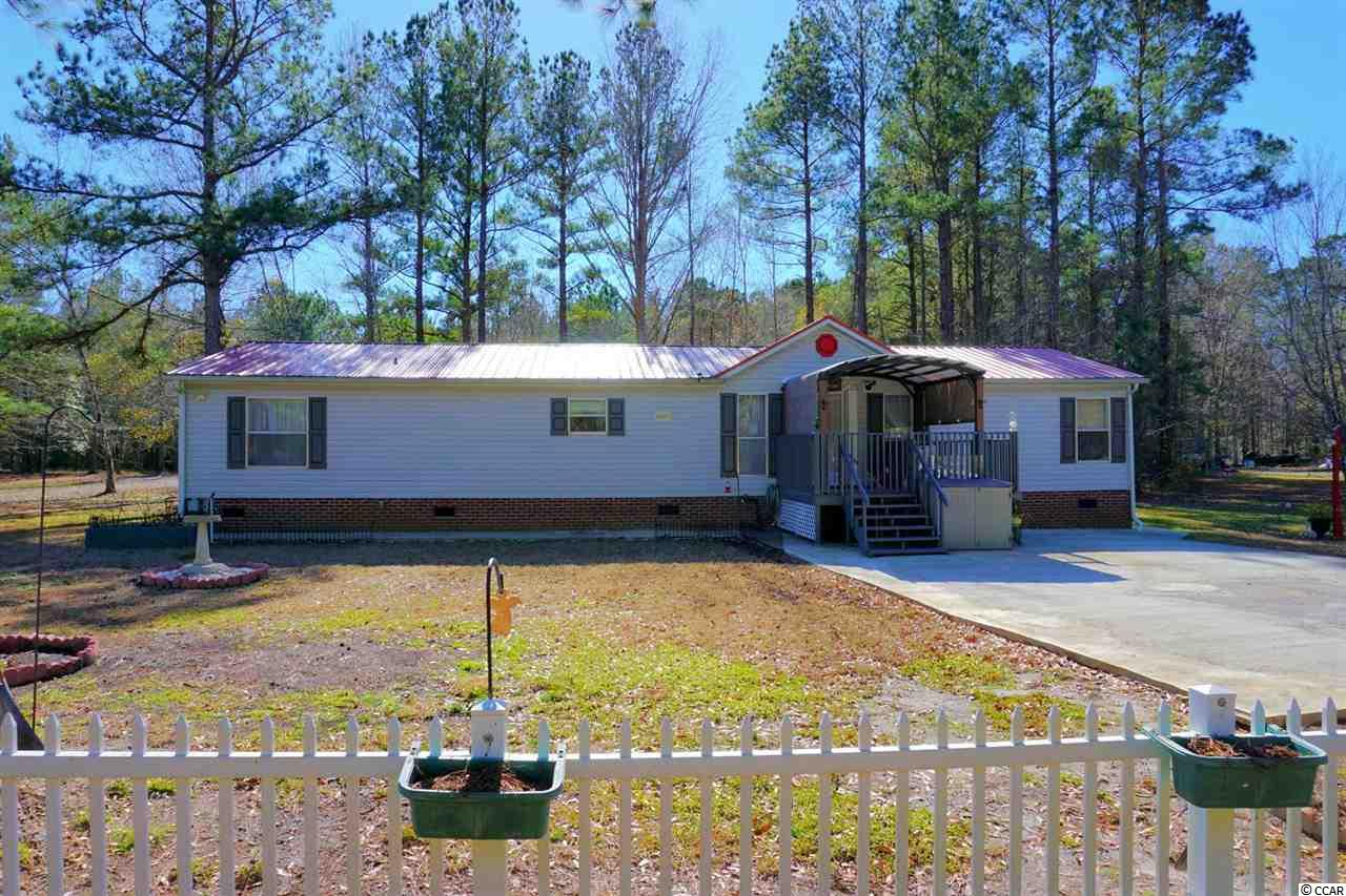 Look at this 3 bedrooms, 2 bathrooms split floorplan home! 1800 Sqft! NEW metal roof, NEW driveway, NEW floors, NEW A/C, NEW appliances, and NEW fixtures! Lots of New upgrades, to many to list. Over a 1/4 acre Lot with no HOA. All measurements are approximate, please verify.