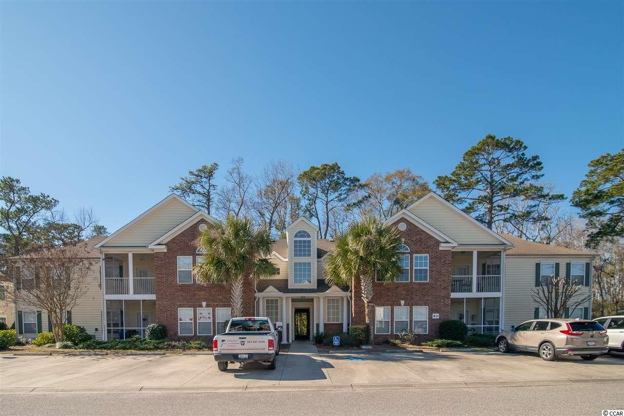 Find your place here in the quiet Pawleys Pointe Community. Unit 60-H is an excellent second floor condo with a beautiful view, its own private stairwell and 3 bedrooms with 2 full baths. The kitchen area features corian counter tops and over looks the dining area. Relax in the spacious living room with cathedral ceilings. Enjoy the nice screened porch off the living room, overlooking a peaceful wooded area. The master bedroom features walk in closets and a linen closet. The private master bath offers dual sinks, a jetted garden tub and separate shower stall. There is a dedicated laundry room. After viewing the condo don't forget to walk down to the private and secluded community pool. Great opportunity for a primary home, rental unit, or a second home to getaway to incredible Pawleys Island. Schedule your showing today!