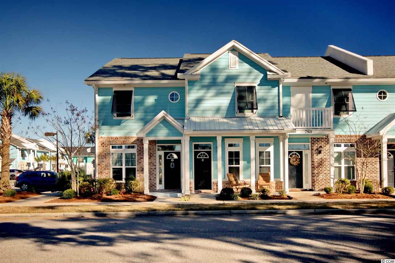 Welcome to your new home in The Market Common, one of the most popular communities along the Grand Strand! This townhome is located in a small community within walking distance to all the restaurants, shops, playgrounds and walking trails The Market Common offers. Inside, you are greeted with all warm and neutral colors, beautiful wood floors, granite countertops in the kitchen and butler's pantry with all stainless steel appliances and crown molding throughout. You will also appreciate the water filtration system the seller is leaving. All your water, down to the water in your washing machine, will be filtered! Off the living room, you have a private courtyard with a detached storage closet. Upstairs, each bedroom has its own private bath and laundry area between the two. This home boasts beautiful finishes and lighting and has been impeccably maintained. Call today for a private showing! This gem in the heart of Myrtle Beach won't last long!