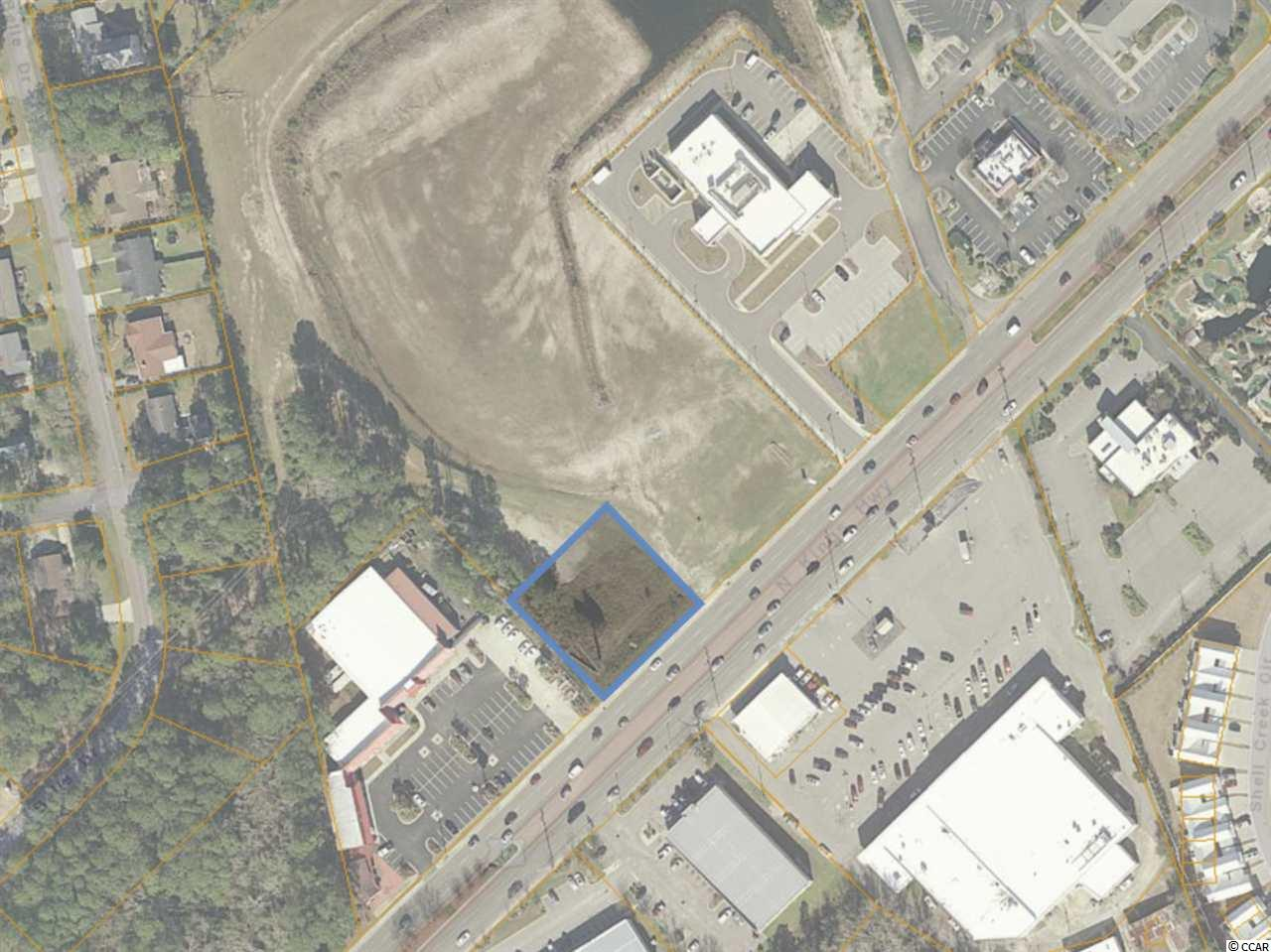 Prime Commercial Lot-For Sale-North Myrtle Beach, SC.  Don't missed this one.   Prime 0.52 acre of Land for Retail, Drive Thru, Restaurant Site in the Growing North Myrtle Beach market in South Carolina. This site has approximately 150' of Frontage along Highway 17. Average Daily Traffic Count 38,40 (Source: SCDOT 2019).   Zoning: Highway Commercial (HC) in the City of North Myrtle Beach, SC. It's centrally located in NMB next to Dick's Pawn Shop and a newly built Grand Strand Emergency Outpost.  North Myrtle Beach is a family-friendly town with top hotels, beach homes , condos for both permanent resident and tourist. Measurements are approximate and not guaranteed. Buyer responsible for verification.