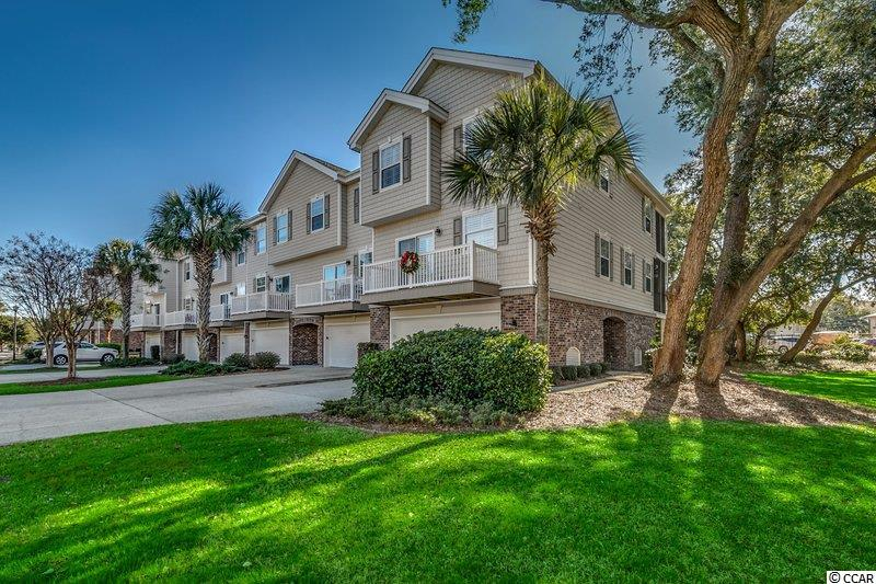 Come visit this 3 BR/2.5BR END UNIT town home in the beautifully maintained gated community of Ocean Keyes. The location is just steps from the beach, main street North Myrtle Beach, and all local area attractions. The community boasts tons of great amenities, including six swimming pools, tennis courts, clubhouses, and a fitness center. The home itself has been well maintained and used only as a vacation home, never rented. Features include beautiful engineered hardwood flooring in the main living spaces, plantation shutters, and lots of storage space. Lots of bright and airy outdoor patios and balconies for entertaining. Both HVAC units have been replaced within the last few years. Inventory is very low in this sought-after community, so hurry and schedule your showing as this unit will certainly not be on the market for long!!