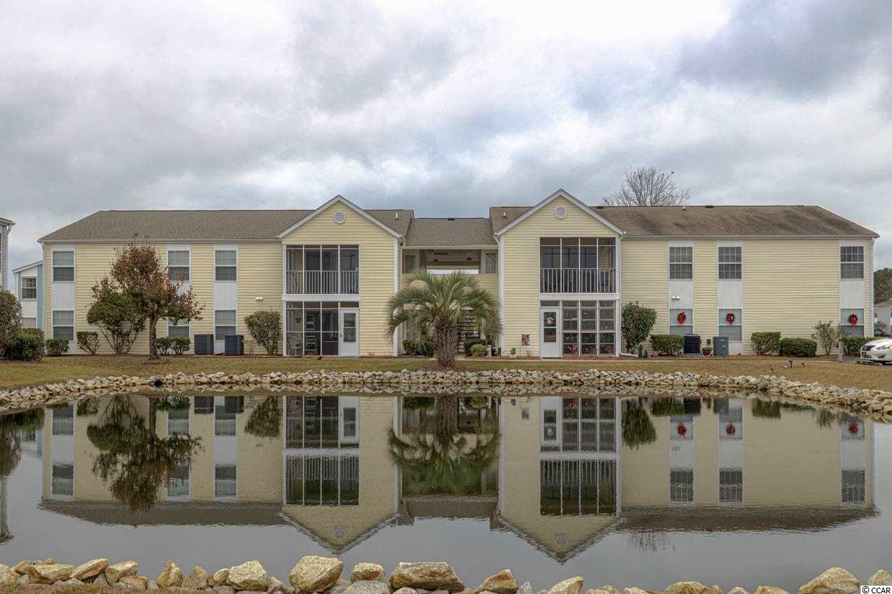 NEW LISTING! SPACIOUS 3 BED/2 BATH CONDO WITH SCREENED IN PORCH OVERLOOKING ONE OF THE MANY PONDS IN SOUTH BAY LAKES! GREAT PARKING! Large open concept unit with spacious rooms and large master bedroom with ensuite and walk-in closet. South Bay Lakes is conveniently located between the 17s in Surfside Beach close to many shops, restaurants and the beach! Prime location with a nice community pool! Now Showing!