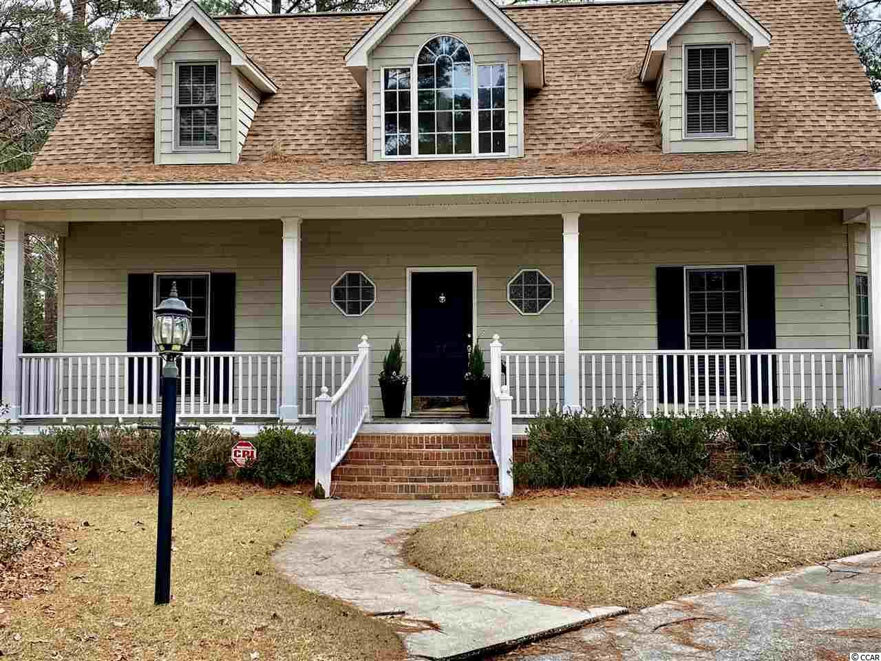 57 Patriot Court is a custom home nestled on the back of quiet cul-de-sac in Wedgefield Plantation. Upon entry, there are cathedral ceilings in foyer and great room. The oversized master suite is downstairs and has beautiful natural light flowing through from the adjoining sunroom. The master bath has a large garden tub and double vanities. The master closet is spacious with double bars and compartments for shoes. The sunroom overlooks the inground pool, patio, deck, and fenced backyard. The great room has a gas fireplace and custom built-ins. This homes provides multiple closets and storage areas. The kitchen has a new gas range, refrigerator, and solid surface countertops. The formal dining is charming with room for a large table. There is a designated laundry room that leads to the garage. There is a 2 car garage with shelving. The upstairs has two bedrooms with double closets in each and a full bathroom. This home is cozy and is perfect for entertaining.