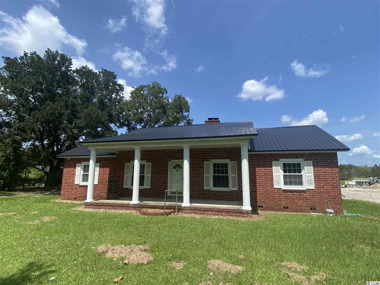 Outside the city limits, and between Georgetown and Andrews, this 3 Bedroom, 1 Bath brick ranch home sits on 1 acre. With a newer metal roof and HVAC, just bring your imagination and plan to update this solid brick home. Hardwood floors, double fireplace, newer windows, updated bath, you are well on your way to making this house your home!  Dont forget you have great proximity to schools, shopping, churches, local boat landings, rivers and the beaches!