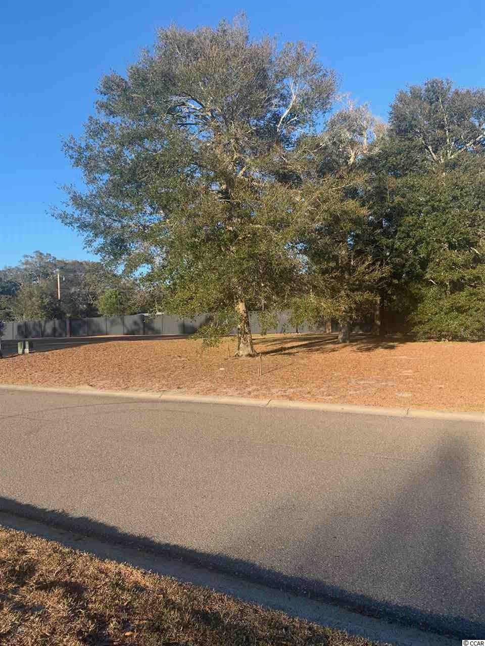Don't miss an opportunity to own one of the last marsh view lots in beautiful Charleston Landing, located on the marsh in the Cherry Grove section of North Myrtle Beach. Build your dream home and enjoy breathtaking views and ocean breezes from this pristine lot, which features several hardwood trees and  convenient access to the waterfront community pool and amenity center, which are within walking distance. Charleston Landing features several amenities including this marsh front pool and clubhouse, playground and basketball court, fishing ponds with gazebos and sidewalks for walking and biking, all conveniently located to the shopping, dining, entertainment and beautiful beaches that Cherry Grove and North Myrtle Beach have to offer.