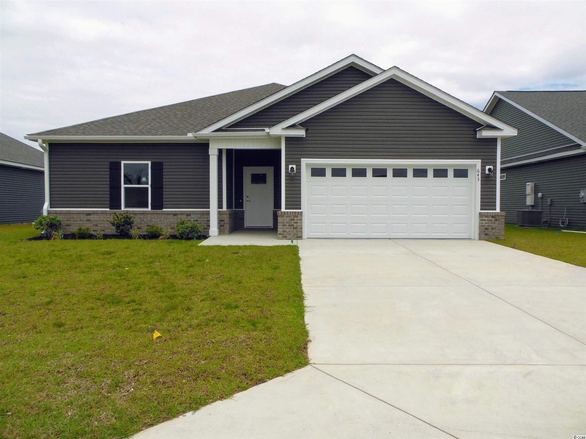 Don't miss out on this New Construction pond view home in The Reserve @ Heritage Downs. This 3 Bedroom 2 bath includes a shiplap wall with a gas fireplace in the Great room/Living room. The kitchen comes with stainless steel appliances (Stove, Microwave, and Dishwasher) upgraded soft close cabinets with granite countertops, a gas range, large work island with a breakfast bar, and pantry for extra storage. The master suite includes double sink vanities and large walk-in closet. Each bedroom includes a ceiling fan and plenty of closet space. Other features include 9' ceilings on the first floor, an optional gas HVAC system, tankless gas water heater, WIFI thermostat, and much more. This house comes with a 12' x 24' POOL Yes! You have a pool in your very own back yard.  Stop by the model home for more information and ask about the new community and other model homes, upgrades. Conveniently located to some of the finest dining, shopping, golf, beaches, schools, hospitals, and downtown Conway, Myrtle Beach, and North Myrtle Beach. **Some of The photos are not of the house, the house is currently under construction. GPS Long Leaf Drive - we will be the neighborhood on the left