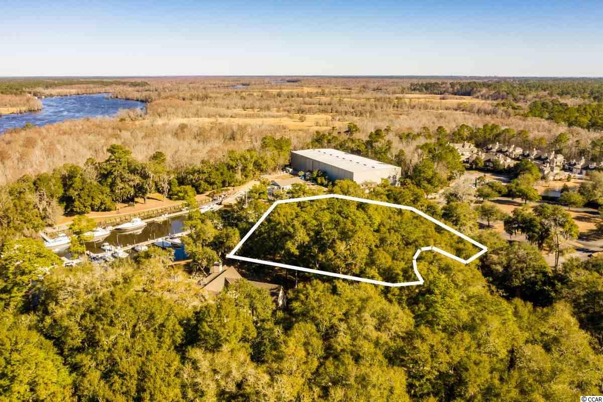 Can it get any better than this?  An estate-sized homesite overlooking a protected-cove Marina on the Waterway in Pawleys Island! This 1.29 acre parcel is located in the Island Estates section of The Reserve, a gated community in the Litchfield area. This section was designed with privacy as a premier virtue. This particular site has attractive gradient topography with a bluff-like feel overlooking the waterfront.  The community itself has an extraordinary amenity package with private beach access via Litchfield by The Sea.  And, access to the Harbor Club Marina and pool and the Greg Norman golf course is available by voluntary memberships.  If you have been looking for a place to call home that allows you to pick your leisure while sequestered in the moss-draped Lowcountry lifestyle, look no further.  Lot 32 on Grove Hill Court is just the place to build your forever home.