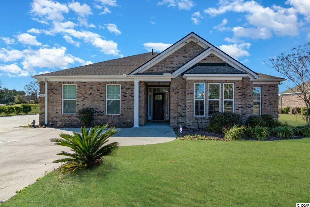 This gorgeous all brick custom home located on the golf course  in the desirable  Wild Wing Plantation community is a must see! No detail has been missed in this beautiful 3 bed 2.5 home that features a fenced backyard with built in BBQ grill,  laminate flooring throughout the entire home, tile floors in the baths and laundry , crown molding in foyer, the living room, dining room and kitchen  and ceiling fans in living room, Carolina room and all bedrooms. Fabulous open floor plan includes a foyer and formal dining room framed  with bead board wainscoting and spacious living room that has direct access to the Carolina room and is also conveniently located adjacent to the kitchen.  The spectacular gourmet kitchen is a chef's dream with granite counters, a work island, abundant cabinet space, gleaming stainless appliances, built in oven and microwave, gas range and range hood, a breakfast bar, a built in desk that is perfect for meal planning or working from home and a huge walk in pantry.  The luxurious master suite boasts tray ceiling, walk in closet and bath with double sink vanities, granite counters, a garden tub and separate shower. There are two additional nice sized bedrooms with abundant closet space and a second bathroom with double sink vanity with granite counter.  In addition, there is a separate laundry room, a half bath and the home also has a tankless Rinnai hot water heater. The expansive Carolina room has shiplap paneling and a triple window that provides wonderful natural light and  is the perfect spot for your morning coffee or favorite beach read . Situated on a .33 acre lot, outdoor enjoyment is guaranteed with an extended paver patio for alfresco dining  and a built in grill for hosting backyard barbeques while enjoying those fantastic views plus the fenced yard is ideal for kids and pets. Enjoy the beautiful sunsets from your back porch over the golf course. There is also a sprinkler system and side load garage with extended allows for plenty o