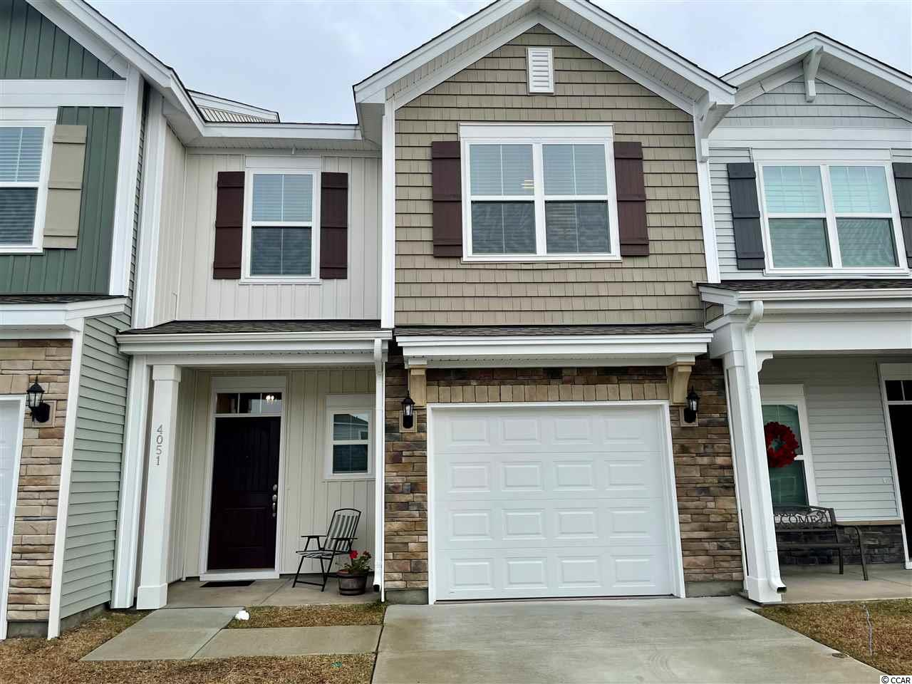 Great opportunity to get a 'like new' town home that is move-in ready in the popular community of Cypress Village.  This floor plan offers the a spacious living room/dining room with an electric fireplace as the centerpiece, a decked out kitchen, and a powder room on the first floor.  It has 2 guest bedrooms upstairs that split a full bath.  This town home also has a huge balcony on the 2nd floor off of the master bedroom which the new construction town homes are not offering.  All stainless steel appliances, washer/dryer, and blinds come with the home as well so you can move right in and start living the good life.  This home is a beauty with too many upgrades to list.  Cypress Village is a natural gas community so this town home comes with a rinnai tankless hot water system, gas heat, and a gas stove.  The HOA Fee covers weekly lawn maintenance, trash and recycling, a resort style pool with a cabana, a fitness center, a lounge area in the clubhouse, bocchi ball courts, and tennis courts.  This one won't last long!