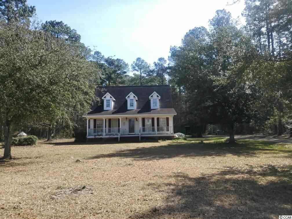 Enjoy two acres of a country setting in the Lambert Town community. Large 2 acre corner lot. This four bedroom two and a half bath home offers lots of possibilities. It is need of repairs but has the potential to make a great starter home for someone willing to do the work. Master bedroom is located on the first floor. Three additional bedrooms and a bathroom are located upstairs. Living room has vaulted ceilings, hardwood floors and a fireplace. Plenty of room for RV & Boat parking or a future workshop.