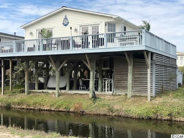 """OCEAN VIEW Roof and HVAC 2017 ! HOT TUBE INSTALLED 2018!  UPDATED andBeautifully decorated 3 bedroom 2 bath MODULAR pier home. Completely TURN KEY and positioned in a cul-de-sac right across from the beach.  This home is in a highly sought after gated community in the """"The Keys""""of Oceanside Village. Located across from the Famous Conch Restaurant.  Amazing wrap around deck offers views of the ocean with warm summer breezes. Plenty ofspace to entertain family and friends on the outdoorBEACHFULLYfurnished deck.  Walk into the elegant updatedeat inkitchen featuring custom granite counter tops with custom tile back splash. Offering UPGRADED STAINLESS STEEL APPLIANCESpurchased in 2018.  Split bedroom, open concept home features upgrades from laminate flooring through-out the main living areas, newer carpet in all bedrooms, newer and updated lighting, electrical and plumbing upgrades all done in 2018.  French doors off the Master RETREAT allow you to enjoy Ocean views and breeze !  2 additional spacious bedrooms and another full bath with ample size laundry room offering more storage area.  Underneath the home you will find another great area to entertain in the hot tub that was just purchased in late 2018.  Private Beach Front Parking"""