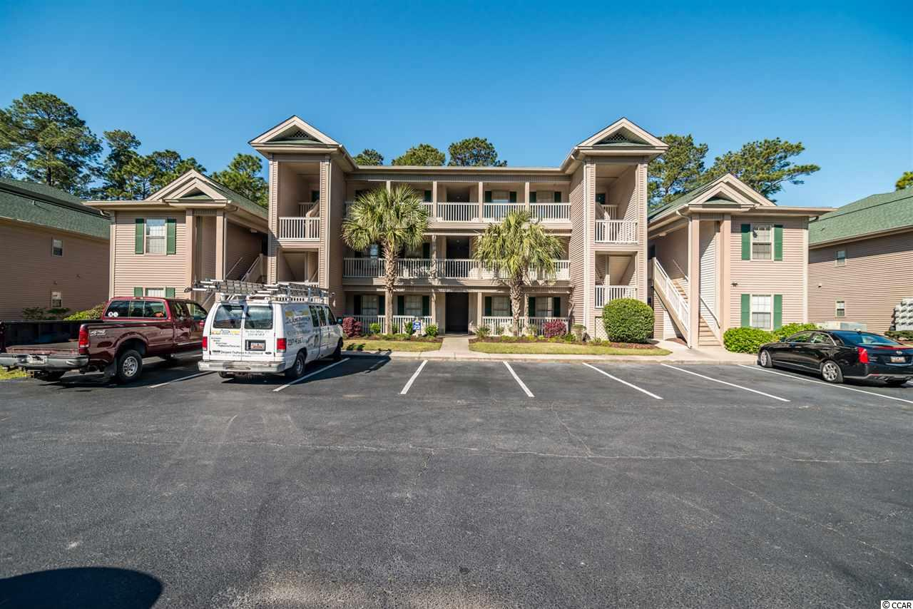 """This is your chance to own your own slice of heaven at the beach! These ground-floor units at True Blue don't come around often. Come see this beautifully-remodeled, first-floor unit situated in the pristine True Blue Golf community in gorgeous Pawleys Island, SC. This ground-floor, fully-furnished 3-BR, 2 Full bath unit features new appliances, stylish furnishings and artwork, newly-installed laminate flooring, fully-stocked kitchen, and gorgeous views of the 17th green. Affectionately named, """"Sweet Spot"""" in homage to its location on the golf course, this condo is perfect as a primary or vacation home. This unit was used as a vacation rental and has an excellent rental history. The unit is situated in a very quiet and relaxing area, beside the 17th green and large pond, with plenty of shade and walking areas. The unit features flat screen TVs in the living room and all three bedrooms, and is only steps away from one of the five community pools/hot tubs and close to the tennis courts. Relax on the screened-in back porch while enjoying the large outdoor fans and taking in the peaceful views of the golf course. The Steve Dresser Golf Academy is located on the True Blue property, just a short walk from the unit. True Blue is nestled off of Highway 17 in Pawleys Island, very close to great restaurants, grocery stores, and shops. Just a 5 minute drive to the Pawleys Island beaches, and the gorgeous, historic Georgetown is only a 15 minute drive south and features a waterfront boardwalk with great shopping and restaurants. Murrells Inlet is a 15 minute drive north - here you can experience delicious locally-caught seafood on the waterfront along with great shopping. Myrtle Beach is only a half hour away and Charleston is about an hour drive. Come claim your """"sweet spot"""" at the beach!"""
