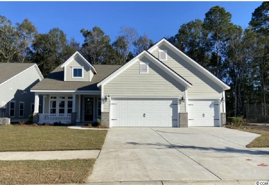 """Now selling Phase 5 Belle Harbor. Best Selling Floor Plan in Belle Harbor! The very popular Lexington Floor Plan has a very  spacious, open floor plan that offers three bedrooms, two baths, 3 car garage, large covered lanai, foyer, laundry room and situated on nice wooded lot! Inside features include stainless steel appliances, solid surface granite counters, 42""""raised panel cabinets, vaulted ceilings, laminate floors, tile and carpeting, beautifully and tastefully appointed through ought, front porch, back covered lanai, low maintenance concrete fiber siding (Hardie Plank) and so much more! Awesome community offering resort style pool, outdoor grill areas, playground, pickle ball court,  and a natural gas community. Great location, approx 2 miles to the beach, walking distance to Market Common, golf cart ride to everything! Walk, ride your bike or golf cart to Market Common, shopping, dining, grocery stores ,movies and other local attractions. Don't miss out on this great opportunity to own your own piece of paradise in one of the most sought after communities on the Grand Strand! Come home to Belle Harbor today and start enjoying the laid back lifestyle that only comes from living near the coast. All measurements and square footage are approximate and not guaranteed. Pictures may include upgrades. Buyers are responsible for verification of all information."""