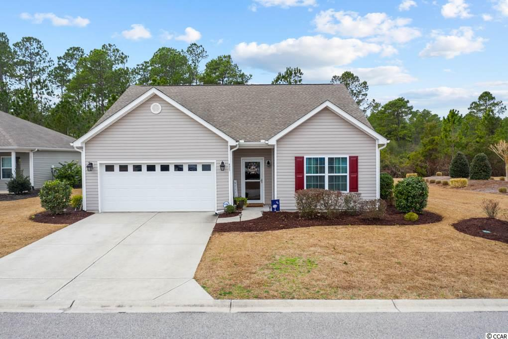 """Seller is a SC Licensed Agent. HOA fee includes basic cable, common area maintenance, pool maintenance, common area lighting, common area insurance and trash pickup. This beautiful home is situated on a larger Estate Lot that borders a wooded area.  The adjacent lot to the right of the home is maintained by the HOA and provides additional privacy. The spacious great room has a vaulted ceiling which is open to the kitchen and dining room. Other upgrades include arched openings, granite counter tops, ceramic tile floors in baths & laundry, irrigation system,  and tray ceiling in owner's suite. This home also boasts a 10'x14' screened porch with 4 track vinyl windows, Hardwood Floors at Foyer, dining room, Hall, Kitchen, Master and third bedroom. Owners bath has five foot walk in shower, with transom window above with linen closet and separate water closet. The master bath also has a raised vanity and comfort height toilet. The kitchen has stainless steel appliances, 42"""" cabinets, pantry and under-cabinet lighting. The second bathroom has a comfort height vanity with a transom window above the bath/ shower combo. This home features additional energy efficiency with fresh air ventilation and air pressure balancing. The spacious backyard is fenced in with three separate gated entrances, including a five foot gate for service entrance. This home also is equipped with a charming ventless built in fireplace, attic with pull down stairs for access to storage, and a subpanel for plugging in a generator during a power outage. It's model home gorgeous and move in ready!"""