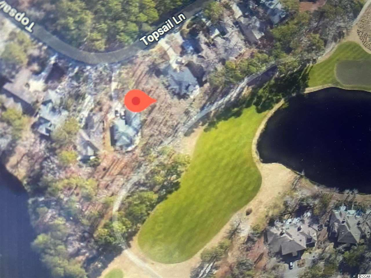 Build your dream home at the beach on this exceptional lot overlooking a lake and hole #10 of the golf course in the prestigious gated golf community of Tidewater Plantation.  Choose your own builder whenever you are ready, there is no time-frame to build.   Tidewater Plantation is a golf course community nestled in the heart of Cherry Grove Beach and along the Intra Coastal Waterway . Like no other in the area, this community offers 24-hour guard security conveniently  nearby to boutique shopping, beloved Cherry Grove beach, and simply the best restaurants.  Tidewater Plantation offers luxurious amenities including access to a private owners only beach cabana in Cherry Grove, numerous pools & jacuzzis, state of the art fitness center, tennis courts, club house with restaurant, and amenity center. The natural landscape and beauty of this community is unparalleled to any other in the area.   Do not delay on purchasing one of last the few lots left with an amazing lake and golf course view!! This wont last long!