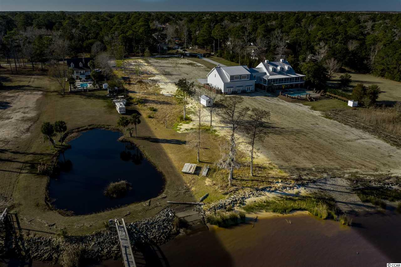 Winyah Bay / Intracoastal Waterway Front!  This rare, residential home site offers 1.48 acres & direct access to the water from your backyard.  These breathtaking views await your future home.  Building your own private dock is possible with correct permitting.  Historic Georgetown is just minutes away by both car & boat.  Hop in your boat and explore the sportsman's paradise that awaits out your back door or enjoy a casual ride to the waterfront restaurants on Front St.  The Georgetown Lighthouse, Atlantic Ocean, Intracoastal Waterway & North Inlet estuary are all just minutes away.  This is the Lowcounty at its finest, you waterfront retreat awaits.