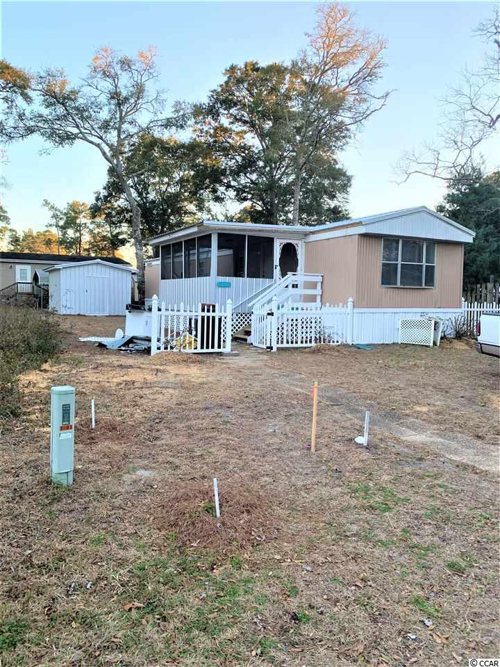 TWO BR/2BATH WITH SCREENED IN PORCH GREAT FOR MORNING COFFEE OR EVENING BREEZES.  LARGE STORAGE BUILDING , ENOUGH ROOM FOR ALL BEACH EQUIPMENT AND GOLF CART DOORS ON BOTH ENDS. 1.2 MILES TO BEACH 1 MILE TO ICW SHORT GOLF CART RIDE TO THE BEACH,ENTERTAINMENT,SHOPPING,RESTAURANTS AND MORE.
