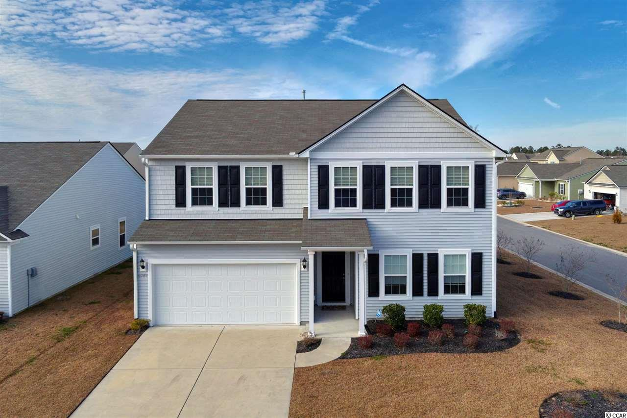 Make plans to view your future home in the highly desired neighborhood of Berkshire Forest. Close to everything the Grand Strand has to offer. Restaurants, beaches, shopping, hospitals, highways, schools, etc. The home has plenty of room for everyone. With five bedrooms and three full baths. The home is three years new and has barely been used. So can have a pretty much brand new home without having to wait for one to be built. Kitchen has stainless steel appliances, granite counter tops, under cabinet lights and walk in pantry. Owner added the wine/dry bar after closing to match the kitchen cabinets and counters. Gives that extra counter space for entertaining and storage for many other things. They also had all the windows completed with sills, frames and blinds. Owner also removed the builders small vanity in the upstairs main bathroom and added a bigger vanity to fill and complete the space. All bedrooms except one have walk in closets. Upstairs also has an extra area that can be used for many things including a play/gaming area for kids or an office space or a sitting area for yourself. Out back the home has a patio and screen-in-porch for grilling and chilling. Berkshire Forest has amenities that are second to none. With its pool, hot tubs, fitness center, kitchen, gas fireplace and grills, basketball and tennis courts and the all new lazy river. Has all this and more!! The facility also has 32 acre lake that it overlooks with walking trails. With the HOA you also have beach access to Atlantica beach resort. So no more paying for or looking for parking when you go to the beach. Home has an ADT alarm system that does convey. Home is also in the award winning Carolina Forest school district. Schedule your showing today and come see your future home.