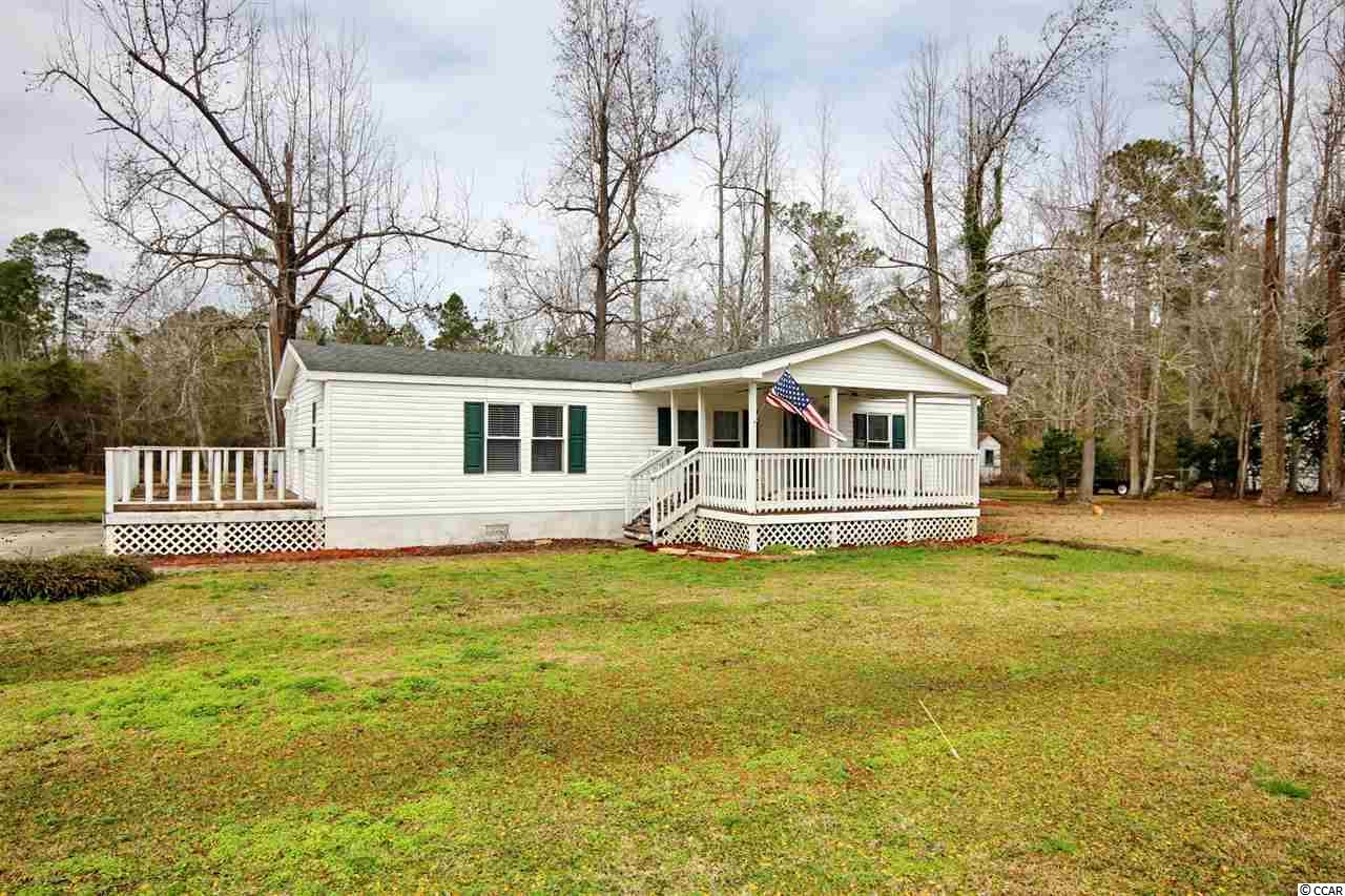 Welcome to this well maintained 3 bedroom 2 bath manufactured home on 1.10 acres!!!! This home has hosted the same family for over 20 years! They have redone the kitchen, updated the flooring and converted the walls to sheetrock and beautifully painted. This home is prefect for a family or an investment. You have NO HOA fees and enough land to create your own paradise within this completely fenced in property!