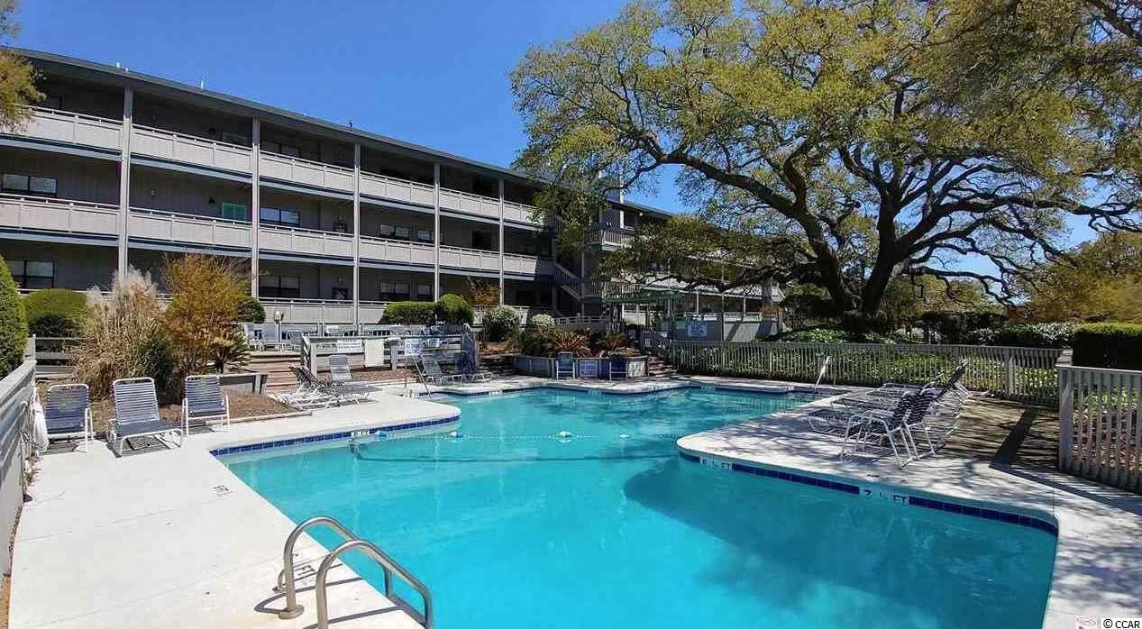 Rare Condo for sale in Sea Grove, only 1 block to the OCEAN!  - Sea Grove has the largest pool in Surfside Beach and is surrounded by large Live Oaks. This gorgeous, well-maintained 3 bedroom condo is beautifully decorated and includes all appliances, full size washer & dryer, furnishings, all wall art, lamps etc. You can live at the beach or use as a vacation getaway or rent (short) weekly or long term. Just off the living room is a large covered deck that offers a view of the ocean! There is laminate flooring throughout main living area, kitchen and bedrooms with ceramic tile in laundry room and baths. Both master and guest baths include vanities with cultured marble counters and decorative mirrors, tub/shower combo with glass doors. Private, spacious master suite with full bath and walk in closet and two other. bedrooms for your guests. Open kitchen with breakfast bar and stools includes black appliances and painted white cabinets with knobs and a separate dining area with lots of windows and chair rail. Large laundry room comes with a dual front load washer/dryer, built in wall cabinets and linen closet. Lots of storage throughout - locked owners closet in hallway, attached storage on the balcony and a second oversized storage room on the ground level is large enough for bikes, fishing poles and all your beach stuff. New Hot Water heater in 2020. This is the only condo available for sale in SeaGrove! The Sea Grove complex offers a spacious outdoor pool surrounded by decking with lots of lounging areas, a covered gazebo with seating and grilling and is surrounded by huge live oak trees. Owners are permitted golf carts and are the preferred mode of transportation to our Surfside Beach with fishing pier, parks and ball field, tennis courts, library, restaurants and dog park. Conveniently located and just a short drive to shopping, beaches, golf courses, boat landings, state parks and lots of restaurants and entertainment venues, health facilities and Myrtle Beach airport.