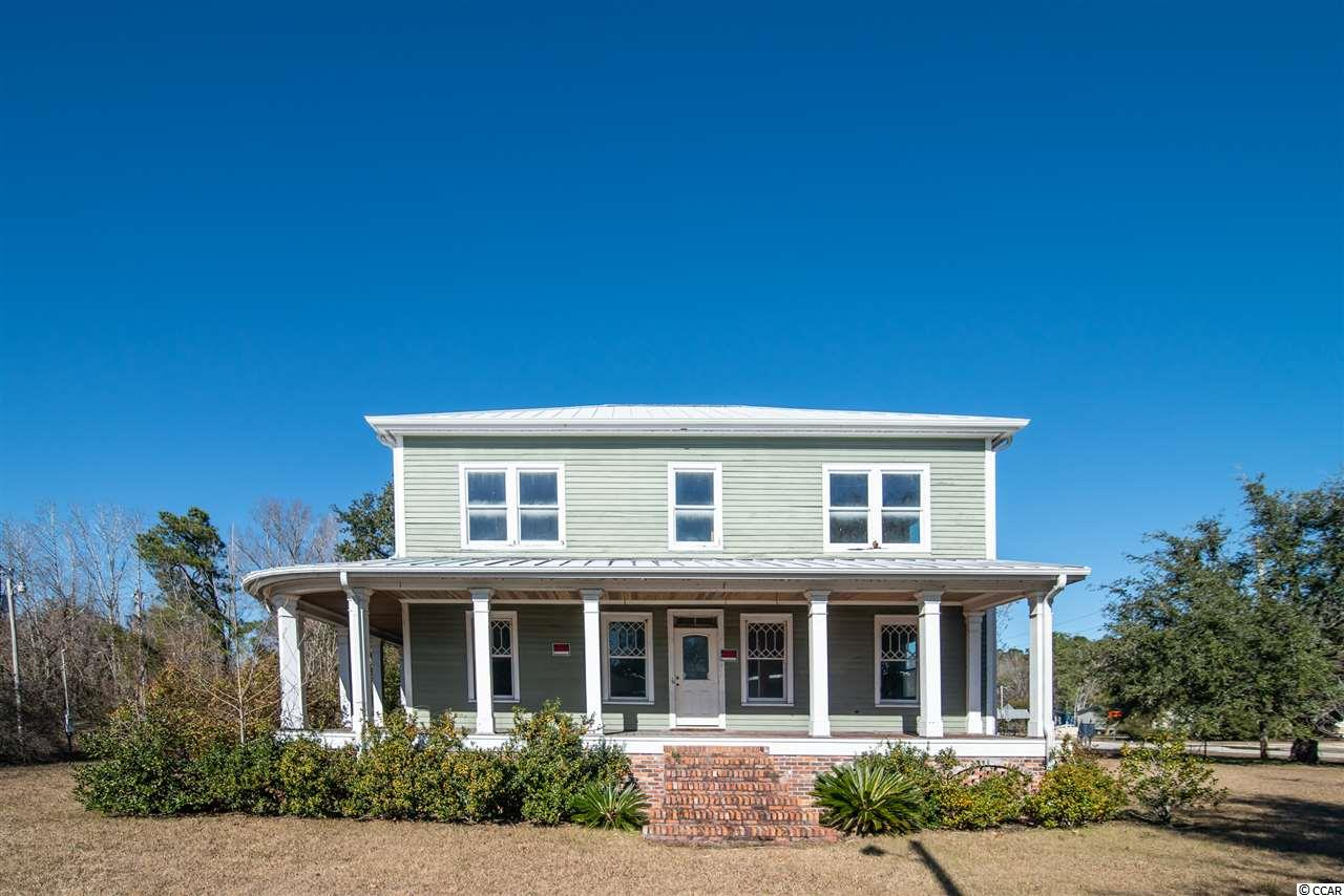 """If you enjoyed watching Extreme Makeover - Home Edition back in the day, and how exciting it was when they yelled """"MOVE THAT BUS!"""", then you'll appreciate the possibilities this beautiful home offers.  Would be a perfect candidate for a home renovation show!  Very unique opportunity to purchase the home and land where it sits or buy the house and relocate it to your own land.  Believed to have been built in 1910, this historic home was moved from the downtown area to this location in 2008 and secured for future refinishing.  It was newly wired and plumbed but never connected to make it easier for the next owner to complete.  Brick skirting was also added around the crawl space foundation.  The original hard wood floors were refurbished and remain covered for protection and some of the original windows remain as well.  If you like older homes you will appreciate the character of the arched doorways, tall ceilings, and welcoming front porch. The floor plan is 4 bedrooms and 3.5 baths and is a blank slate waiting on your design and finishes.  Situated on a corner .55 acre lot which could possibly be zoned commercial.  Again, the home and lot can be purchased together or separately and the current owner has cost estimate to move the house. *Buyer is responsible for verifying square footage."""