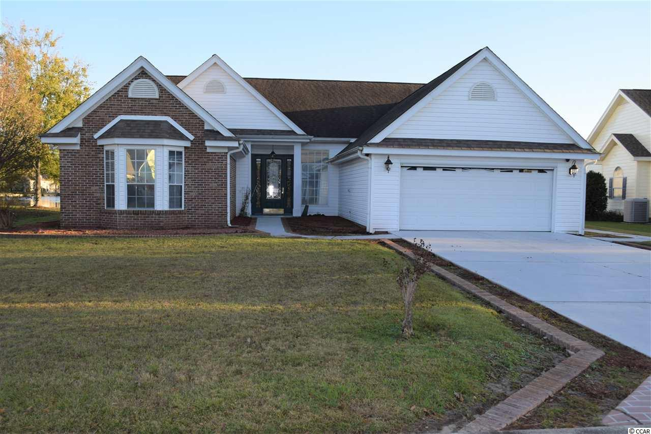 """A most see home on the lake located in a long established neighborhood a few miles from the beach, airport, Market Common, Murrells Inlet Marshwalk, Coastal Carolina University and lots of shopping and restaurants. Priced to sell. The home has had one owner who kept the house clean and up to date. The lake can be seen from the MB, Family room, and enclosed porch. A quaint outdoor deck situated just over the bulkhead on the lake can be a peaceful and serene place to enjoy your morning coffee or evening cocktails.   There is a fireplace in the family room off the eat-in-kitchen plus a dedicated dining area in the large living room.  A Carolina room and an enclosed porch add lots of room to relax and enjoy the beautiful view.  Many extras just add to the overall beauty of the home. The home is being sold """"as is"""". There will be no repairs and no disclosures. Measurements are approximate and the responsibility of the buyer to verify."""