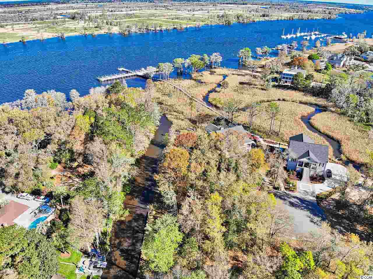 Build your dream house on this beautiful waterfront lot  in the Rivergate subdivision of Pawleys Island.  This lot with bulk head is situated on a tidal canal leading to the Intracoastal Waterway/Waccamaw River.  This community is a quiet cul-de-sac neighborhood with a total of 14 lots located on the waterway between Hagley and Heritage Plantation.   Rivergate owners also enjoy a common dock on the Intracoastal Waterway.  A DEEDED BOAT SLIP CONVEYS WITH PURCHASE!  Owners have the right to put in their own private boat lift.  Jump on your boat for an evening sunset cruise  or for a weekend trip on the Intracoastal to Myrtle Beach or Charleston, SC.  Pawleys Island beaches are just minutes away.  Close to fine dining, boutique shopping and more.  Pawleys Island is just a 65 mile drive to historic Charleston, SC or a 30 mile drive to Myrtle Beach!