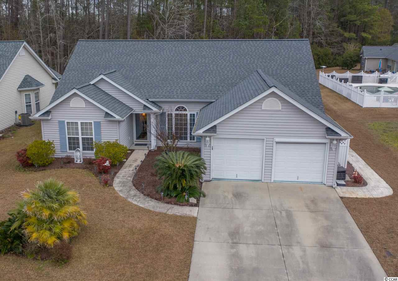 This open floor plan home is located in the established community of Springfield in Murrells Inlet and is approx 4 miles to area beaches. A well loved home that's situated on a .58 acre wooded lot. Plenty of room for kids, pets or the pool you have been wanting. This home includes 3 bedrooms, 2 bathrooms, a formal living room and dining area, vaulted ceilings with fans, a spacious eat in kitchen offering plenty of counter top space for the cook in the home, all appliances included, breakfast bar, bay window all opening up into a family/gathering room with gas fireplace. Two sets of sliding glass doors lead out to the show stopping 34x16 screen porch with tile flooring, fans and skylights. A great place for relaxing and entertaining! The spacious 19x16 master suite boasts vaulted ceilings and a master bath with a 6' whirlpool tub, double vanity, separate shower with glass enclosure, linen closet and walk in closet. Two additional large guest bedrooms are located on the front of the home giving privacy to the master bedroom. You will also find an oversized 2 car garage with pull down stairs leading to attic storage space, side service door that leads to an attached 5x8 shed, as an bonus one garage door even has an electric screen you can open the door and keep the air flowing through will you work in the garage. Extra features - every room has an AC return for better air flow, whole house dehumidifier, HVAC 2015, AeroTherm heat pump water heater 2018, roof 2018, stove 2016, all new flooring 2016. HOA includes trash, community pool, maintenance common area, and basic cable with 2 boxes and 1 DVR. Oceanfront fishing piers, Market Common, oceanfront Myrtle Beach and Huntington Beach state parks, airport, championship golf courses, the Murrells Inlet Marshwalk, Brookgreen Gardens all just minutes away. Call today to schedule an appointment to see this lovely home! Square footage is approximate and not guaranteed. Buyer is responsible for verification.
