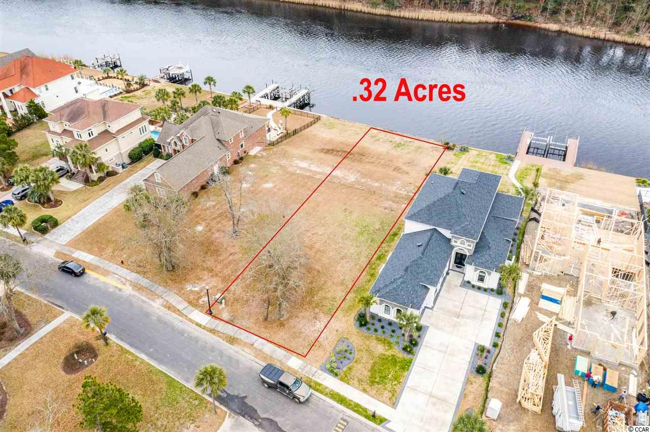 WONDERFUL OPPORTUNITY to own a  LARGE LOT in the prestigious, gated Carolina Forest community of The Bluffs on the Waterway. This FULLY CLEARED build site DIRECTLY ON THE INTRACOASTAL WATERWAY is ready for the approved custom builder of your choice! Enjoy LOW HOA fees, perfect views, and NO TIMEFRAME to build! The world-class amenities at The Bluffs include: Playground, 2 clubhouses, boat launch, boat storage, sidewalks, tennis courts, community pool, stocked fishing pond, gazebos and security. Located near great schools, championship golf courses, hospitals, restaurants, attractions, shopping and ONLY 15 MINTUES from the BEACH!! Call Today.