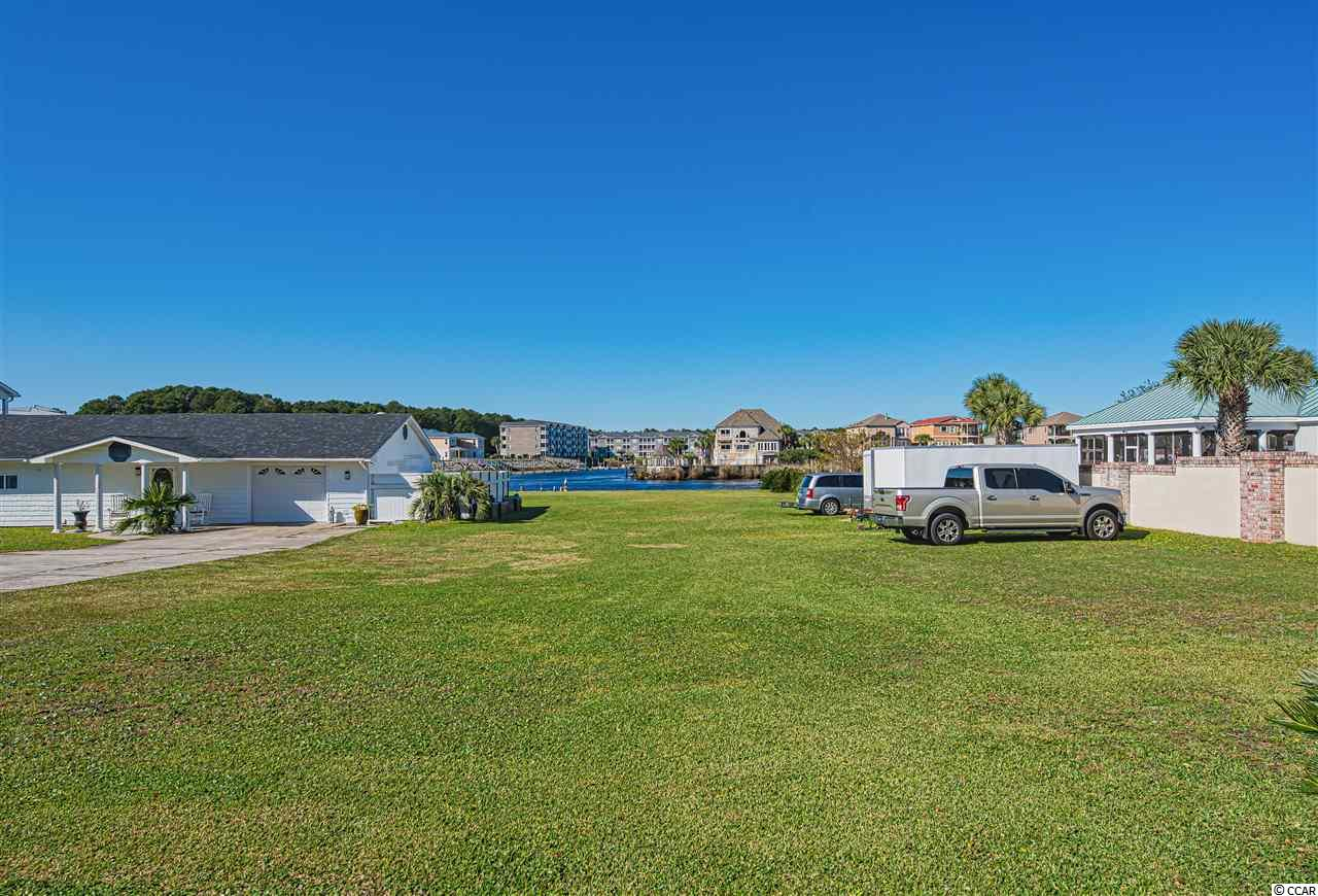 Beautiful views on this direct ICW (Intracoastal Waterway) piece of land/lot. Beautiful lot to build your custom dream home on! If you need information on property or possible builders, call agent! Centrally located in the heart of North Myrtle Beach with easy access to many restaurants, Gyms, Boating/Boat Life, stores, grocery, golfing and more. NO HOA. Home to the left of lot is also for sale separately on separate listing. Fence has since been removed from property to the left.