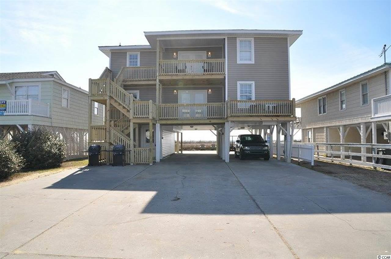 Here is your money maker.  Excellent rental.  This is a duplex.  There is an upper unit and a lower unit.  Both are exactly the same.  Each has 3 br and 2 ba.  Direct oceanfront, fenced in back yard, great location near everything and views to die for.