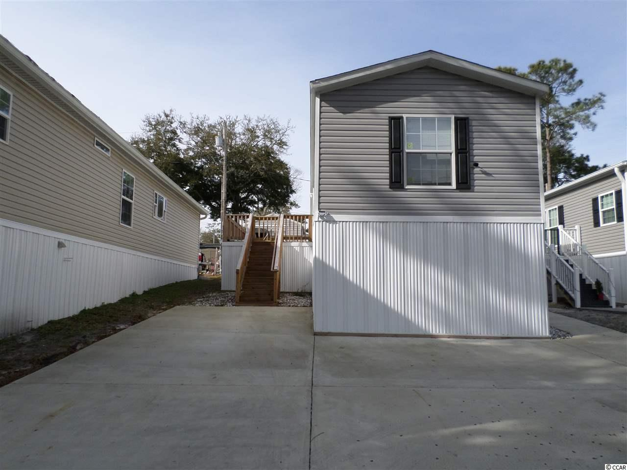 Location, location!  This beautiful 2018 Fleetwood Westfield 16 X 66 Manufactured home is ready for immediate occupancy in the desirable Apache Campground which offers residential annual leases and vacation spots.  The home has a large 10 X 20 front deck with security gate, 4 X 6 rear deck, 10 X 14 storage building with galvanized metal roof,  3 car cement park pad and sidewalk.   The home boasts residential sheetrock throughout, freshly painted, whirlpool kitchen appliances to include, stove, refrigerator, dishwasher. Formica countertops and plenty of cabinet space adorn the kitchen area.  The washer and dryer conveys with the sale.  There is a storage door on the back of the homes vinyl underpinning to allow for additional storage of beach chairs, children toys, Christmas decorations, etc.  The 3 ton HVAC has a cover to restrict debris entry. Thermopane windows are featured throughout.  Ceiling fans have been installed in the den/kitchen/master bedroom.  Floor covering is linoleum which is easily maintained.  This beautiful home is a short walk or golf cart ride away from the beautiful Apache pier and Atlantic Ocean. Apache Campground has two pools, a general store, playground area, arcade, restaurant, the pier featuring entertainment and beach access. This location and property is absolutely beautiful and a must see!