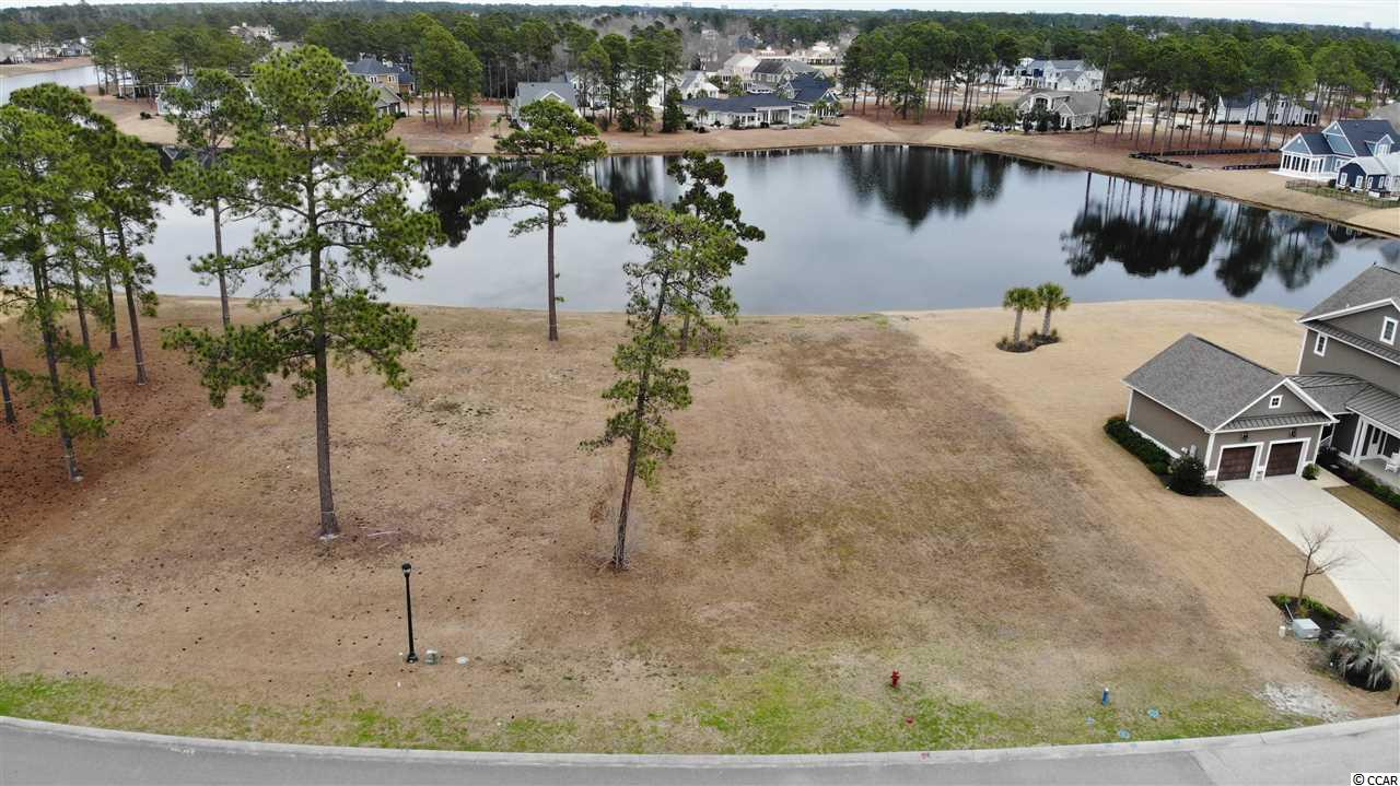 """756 Waterbridge Blvd is a fantastic lakefront homesite in one of Carolina Forest's hottest communities.  No time frame to build, """"Buy Now, Build Later."""" Build your dream home and enjoy the fantastic views and amenities this community has to offer. The amenity package at Waterbrdige afforded to property owners is like no other.  The resort-like tropical pool will make every day seem like a Caribbean vacation. In addition to the largest residential pool in South Carolina, the following amenities are enjoyed by the homeowners and their guest: Village style clubhouse, Resort-style swimming pool, Walking trails, Firepit, 60 plus acre Palmetto Lake, Fitness center, Nature pocket parks, Small vessel boat storage, Sand volleyball, Two tennis courts and more!"""