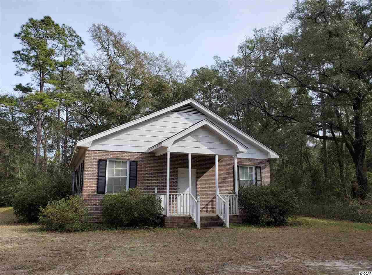 Unique Opportunity to own over an acre of land in Murrells Inlet with 1280 heated Square feet Brick building. Could be used as a residence with some additions of walls inside or workshop. Property is zoned 1/2 acre residential. Possibly divided.