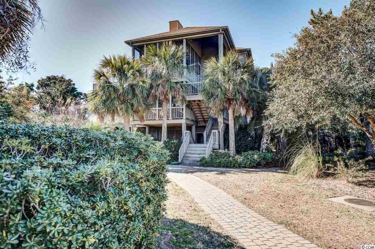 "Location, location, location.  Located on the creek, steps to the beach, and just a short distance to the pool, this well maintained home boasts magnificent views of the ocean, creek and salt marsh.  In a gated community with 24 hour security, Inlet Point South offers many amenities including a swimming pool, boat landing, and not to mention access to the beach.  The shared covered dock (shared with the neighbors on either side of the house) allows access to the creek for boating, fishing, kayaking, and crabbing.  The home features a crow's nest as well as numerous porches to enjoy the surrounding views and to listen to the sound of the ocean.  The home is an inverted floor plan, with the main living area and master on the third floor.  The main house has 4 bedrooms, and 4 1/2 baths, and the ""annex"" which was added in 2010 has 2 bedrooms and 2 baths.  The annex is accessed from the second floor through a covered walkway. The elevator is accessed from underneath the house and services all three floors. The home has an established rental history with great income. S. Litchfield Beach is just 5 miles south of beautiful Brookgreen Gardens, and 60 miles north of historic downtown Charleston. Don't miss this opportunity to own such a unique piece of property at the beach!"