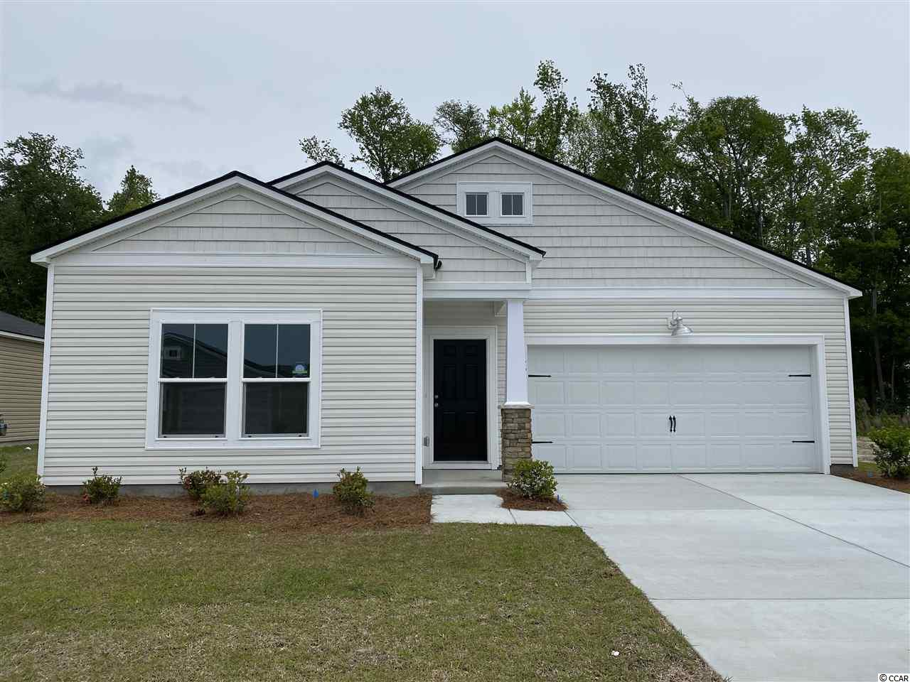 "These pictures are of a ""Similar Home"", it is a MODEL home with extra options.  Beach Village is our community located in Deerfield. This Dover is 3 bedroom 2 bath. This home features Granite kitchen countertops with subway tile. Stainless steel appliances and Laminate flooring. A gas community with a tankless water heater and gas stove.  Low HOA, Internet & Cable"