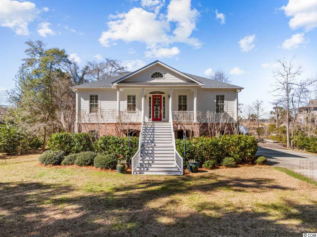 "This riverfront home is located on the former Deer Hall Plantation on the Black River. Inspired by Thomas Jefferson's ""Edgemont"" in Virginia, the current owners oversaw the building of this highly desirable residence.  The open concept of the main level features high ceilings, heart of pine flooring, and expansive crown molding. Upon entering, the spacious hallway leads you to the main living area which is shared by the open concept kitchen designed to provide a large entertainment area with a river view. The main level also houses the master suite, one guest bedroom, an office, powder room, and laundry. Step out to the screened porch to enjoy magnificent sunsets and outdoor living.  Venture downstairs to a third bedroom suite, and a two and a half car garage with attached workshop for the serious craftsman.  In order to take full advantage of this fabulous property, amble down the walkway through the cypress marsh to the dock. There is a permanent structure as well as a floating dock for easy launching of smaller vessels. This lovely home is located in an outstanding neighborhood with a private boat access for larger boats if you so desire."