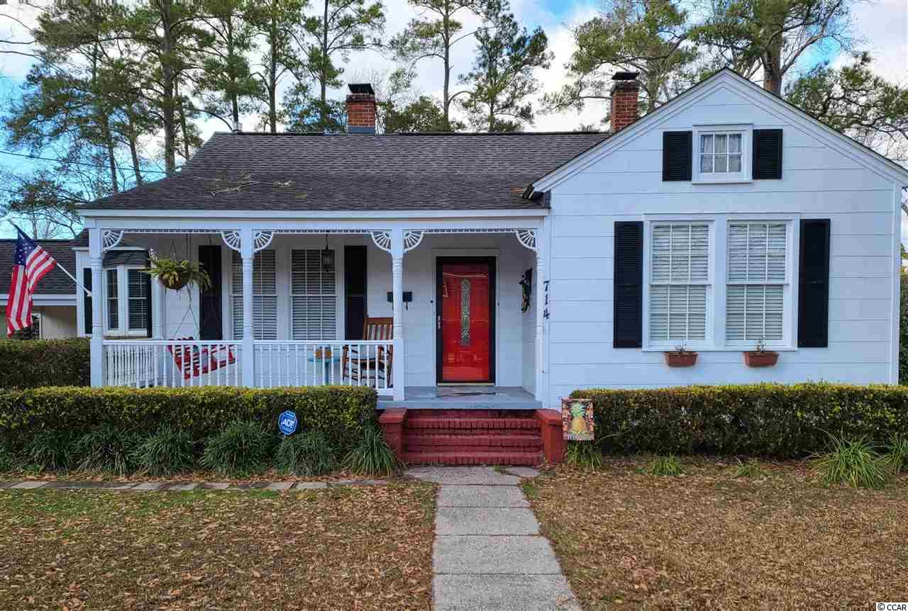 Charming home in downtown Conway just blocks from Horry County Library and Museum, local shops, wonderful restaurants, theater, and the well-known Riverwalk.  All the daily living conveniences are also nearby such as grocery stores, medical offices, banks, and just 0.3 miles to both an elementary school and middle school!  This 3 bedroom, 2 full bathroom home on 0.43 of an acre is such a treat found in a great location! The main living areas are spacious with a separate den and living room with a quaint gas fireplace.  The original oak hardwood floors are in wonderful condition and add so much character to the home.  The modern conveniences have been completed for you with fresh paint throughout the house and two fully renovated bathrooms with tiled floors, tiled showers, new windows, light fixtures, vanities, exhaust fans, and accessories. The kitchen updates include a stainless steel refrigerator and dishwasher, plus the mosaic tile backsplash, pantry, and pull out drawers in the lower cabinets. The hot water heater was replaced in 2019, the roof and Trane HVAC are just 7 years old,  and the 2020 French doors from the updated den lead out to a new wooden deck. The dining room, adjacent to the kitchen, is the true heart of the home with a new sunny bay window, modern light fixture, and wainscoting/chair rail. From the dining room, take one step down to the laundry room area and carport entrance which then leads down just two more steps to the 12 x 16 master en suite complete with double closets and one of the modern bathrooms. The home is a split bedroom floor plan with the two guest rooms on the other side of the house off the main living room. Both guest rooms are good size with ceiling fans and hardwood floors. Between the guest rooms is the 2nd updated bathroom with the walk-in tiled shower and linen closet. The other two hall closets provide plenty of storage inside. The outside storage is endless with an enclosed closet under the carport, an extra wide shed, 