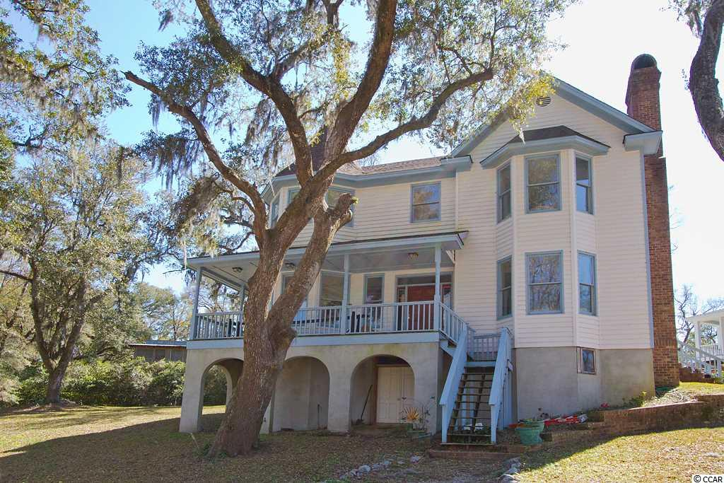 Sun sets in your backyard over the Waccamaw River.  Large stately live oaks dripping in Spanish Moss, surround the elegant Victorian Home.  House built on a 1830 Historic Plan.  Walk to the end on your private dock, drop your boat in the water and cruise to Georgetown for dinner. Seller is a licensed South Carolina Real Estate Agent.